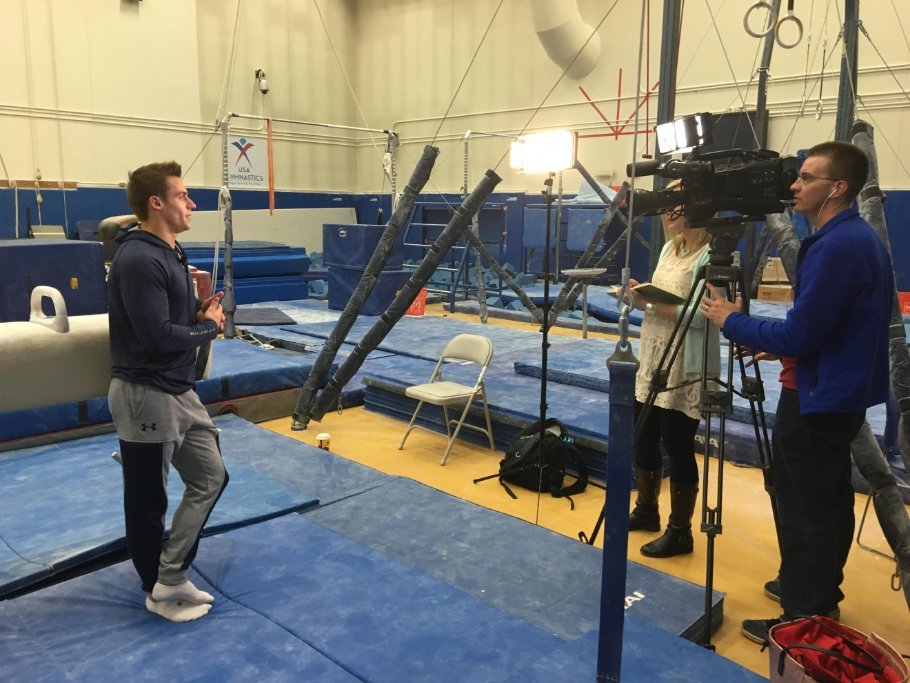 NBC 25 Photographer, Michael Horne, and Anchor, Sadie Hughes, at the Olympic Training Center in Colorado Springs, Colorado, interviewing Team USA gymnast, Sam Mikulak. Photo Credit: Anna Avery.