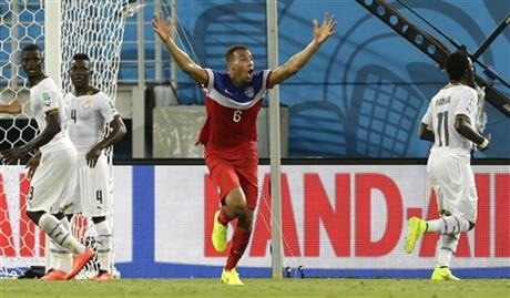 United States' John Brooks, centre, celebrates after scoring his side's second goal during the group G World Cup soccer match between Ghana and the United States at the Arena das Dunas in Natal, Brazil, Monday, June 16, 2014.