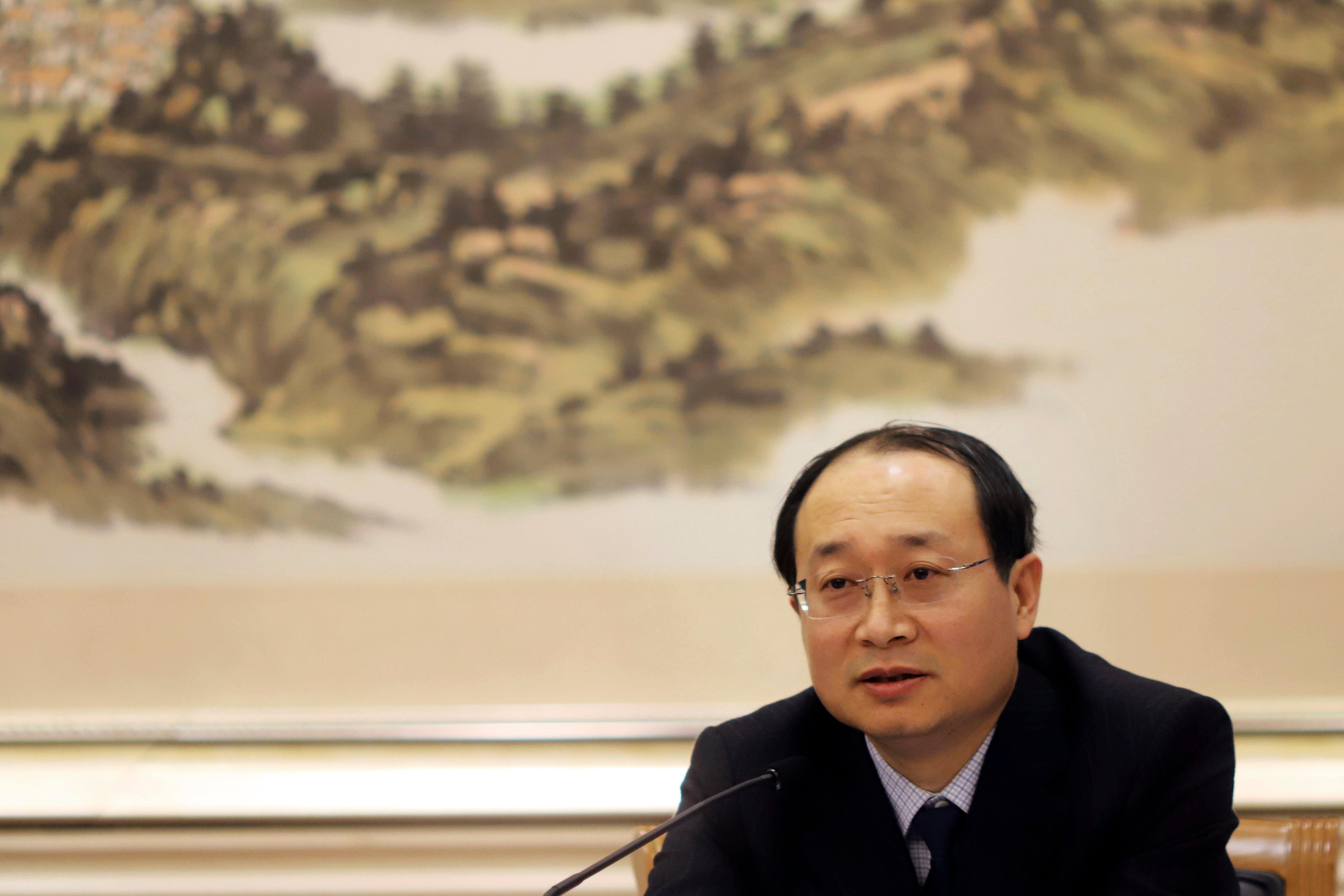 Yu Haibin of the China National Narcotics Control Commission speaks during a press conference held in Beijing, China, Thursday, Dec. 28, 2017. Yu said Thursday there was little evidence showing China was the source of much of the chemicals used in the production of the powerful opioid fentanyl. (AP Photo/Ng Han Guan)