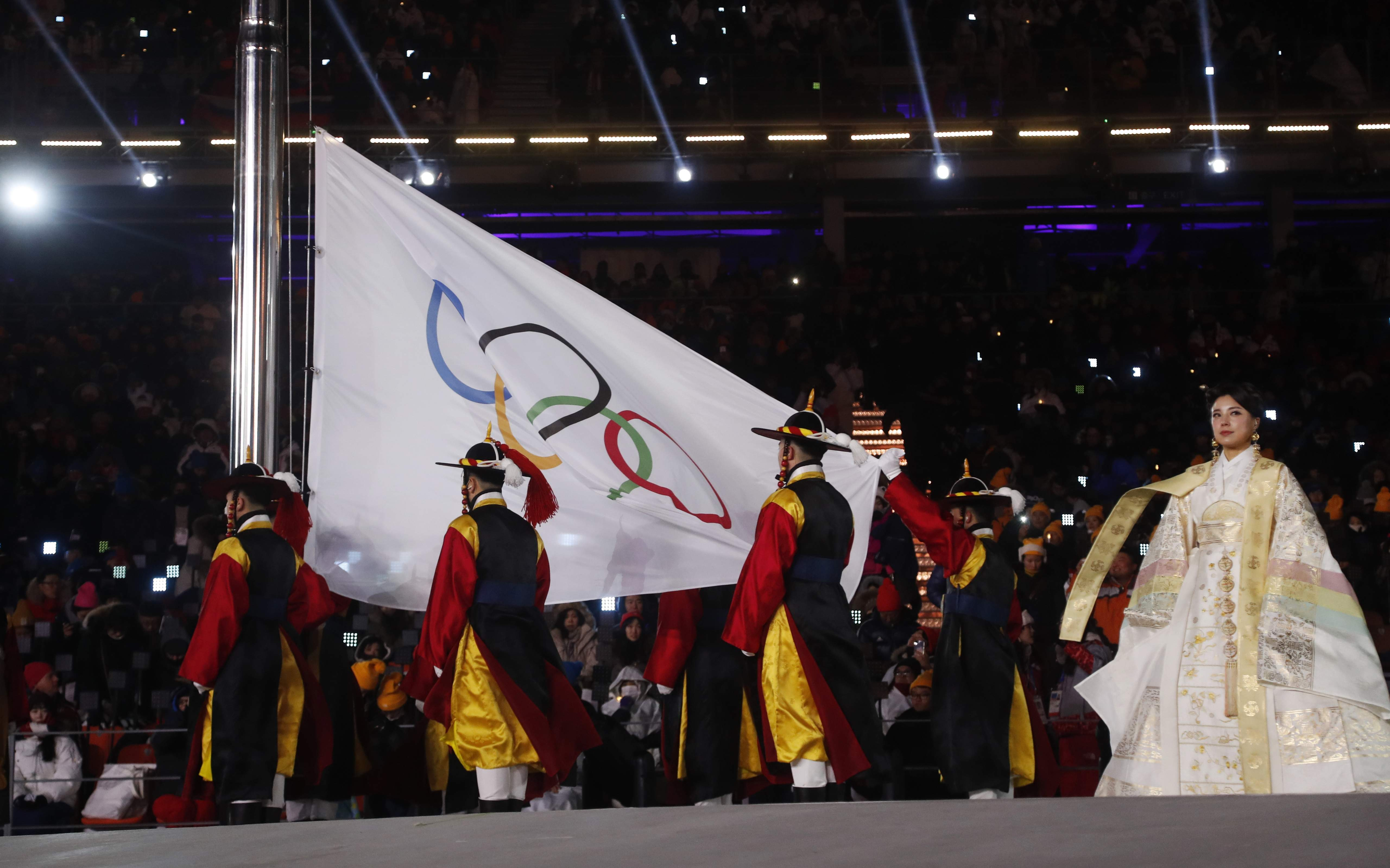The Olympic flag is raised during the opening ceremony of the 2018 Winter Olympics in Pyeongchang, South Korea, Friday, Feb. 9, 2018. (AP Photo/Petr David Josek)