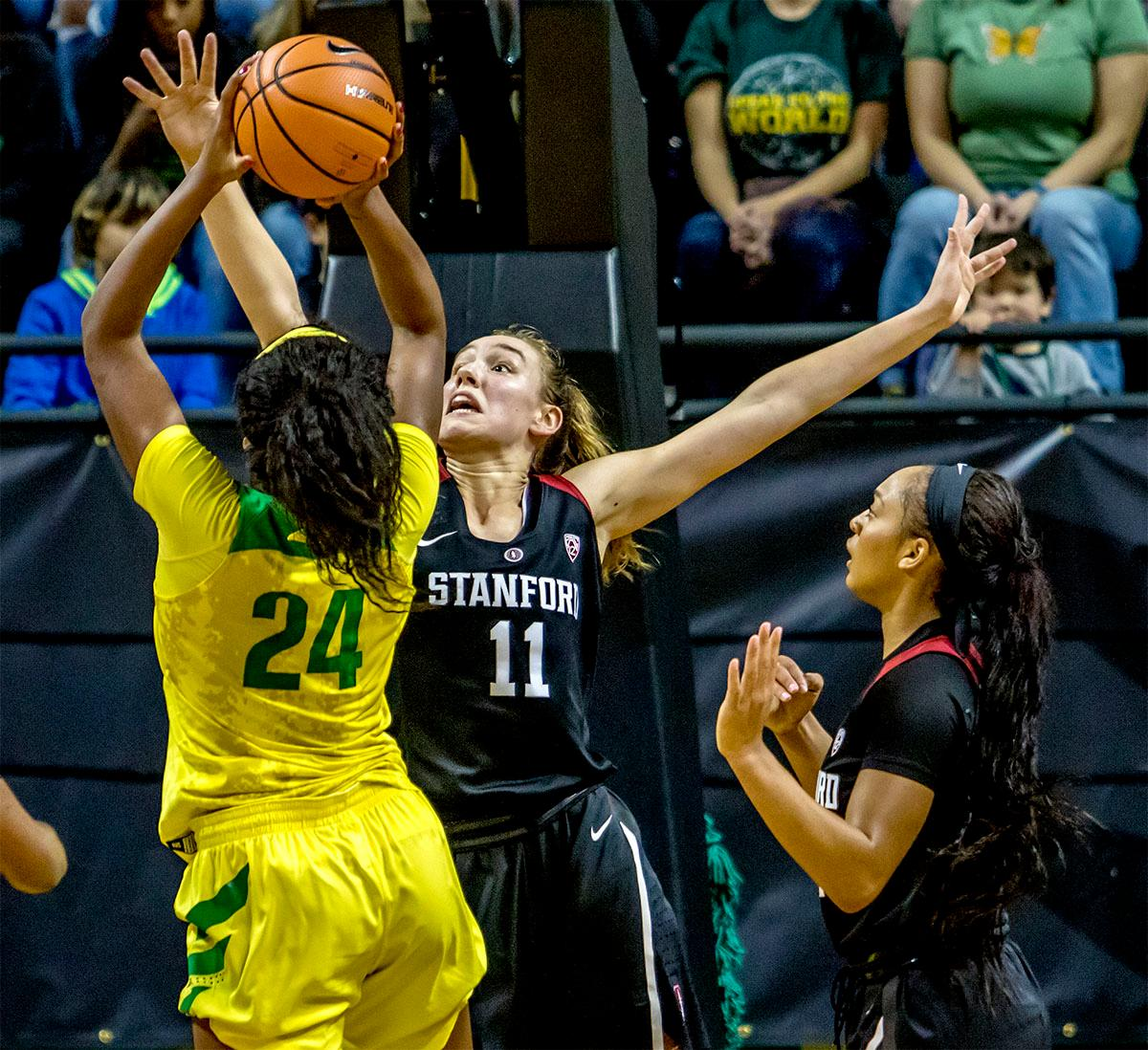 The Duck's Ruthy Hebard (#24) makes a shot as the Cardinal's Alanna Smith (#11) defends. The Stanford Cardinal defeated the Oregon Ducks 78-65 on Sunday afternoon at Matthew Knight Arena. Stanford is now 10-2 in conference play and with this loss the Ducks drop to 10-2. Leading the Stanford Cardinal was Brittany McPhee with 33 points, Alanna Smith with 14 points, and Kiana Williams with 14 points. For the Ducks Sabrina Ionescu led with 22 points, Ruthy Hebard added 16 points, and Satou Sabally put in 14 points. Photo by August Frank, Oregon News Lab