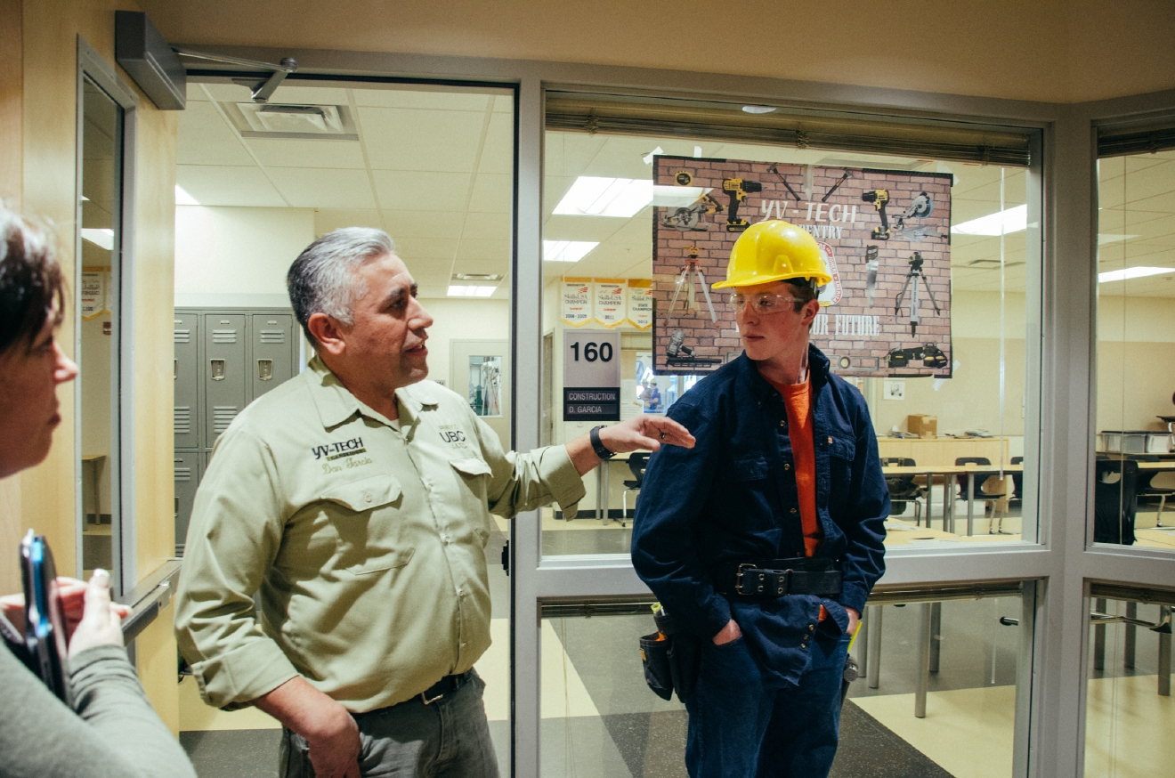 An instructor at Yakima Valley Technical Skills Center (YV Tech) and one of his students explain what the Center's cirriculum covers during a Washington STEM Learning Tour.