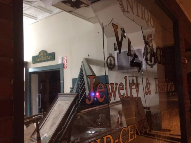 Putnam police released this image of a broken window at the Antiques Marketplace, where they found a naked man going on a rampage inside.