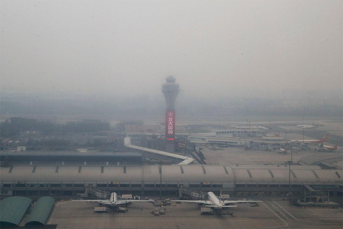 Passenger planes are on the tarmac at the Beijing Capital International Airport shrouded by pollution haze in Beijing, Thursday, Nov. 17, 2016. Authorities in Beijing on Wednesday warned that heavy pollution will persist this week, urging the suspension of outdoor school activities and construction projects. (AP Photo/Andy Wong)