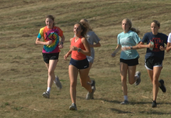 Reese Hogan leading a group of runners at St. Thomas More cross country practice.