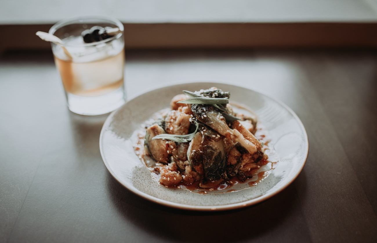 Roasted cauliflower sprouts with sesame seeds, green onions, and a sweet-chili glaze / Image: Brianna Long // Published: 5.17.18