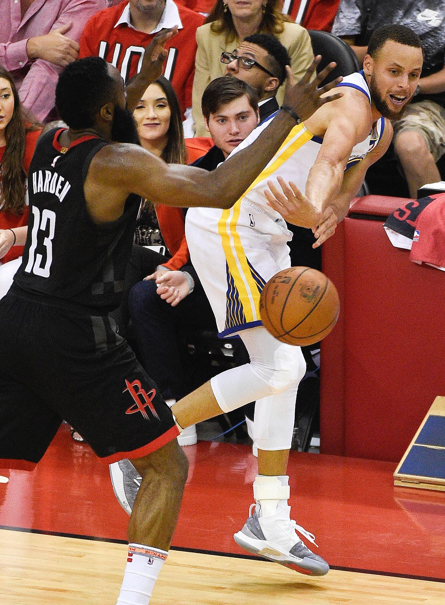 Golden State Warriors guard Stephen Curry, right, passes the ball as Houston Rockets guard James Harden (13) defends in the second half during Game 1 of the NBA basketball Western Conference Finals, Monday, May 14, 2018, in Houston. (AP Photo/Eric Christian Smith)