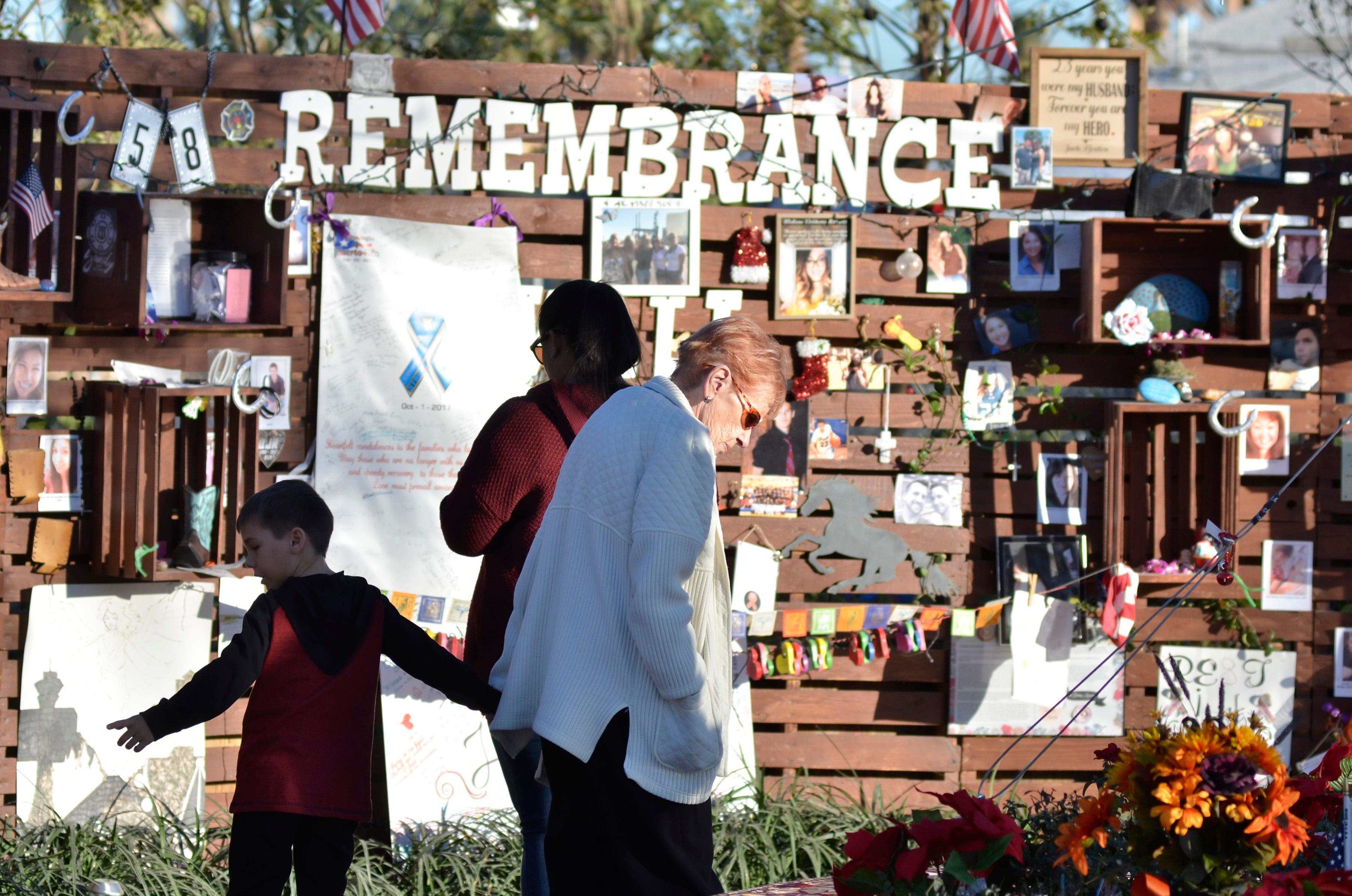 Visitors to the Remembrance Wall are shown in the Community Healing Garden at 1015 S. Casino Center Blvd. in Las Vegas on Tuesday, Dec. 12, 2017. CREDIT: Bill Hughes/Las Vegas News Bureau
