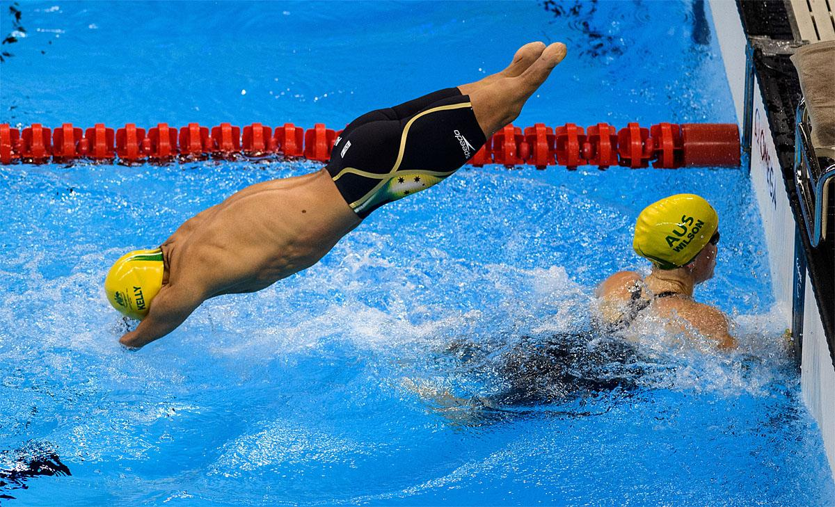 In this photo provided by the IOC, Australia's Ahmed Kelly and Kate Wilson, competes in heat 2 of the mixed 4x50-meter freestyle relay - 20 points swimming event at the Olympic Aquatics Stadium during the Paralympic Games, in Rio de Janeiro, Brazil, Friday, Sept. 9, 2016. (Bob Martin/OIS,IOC via AP)