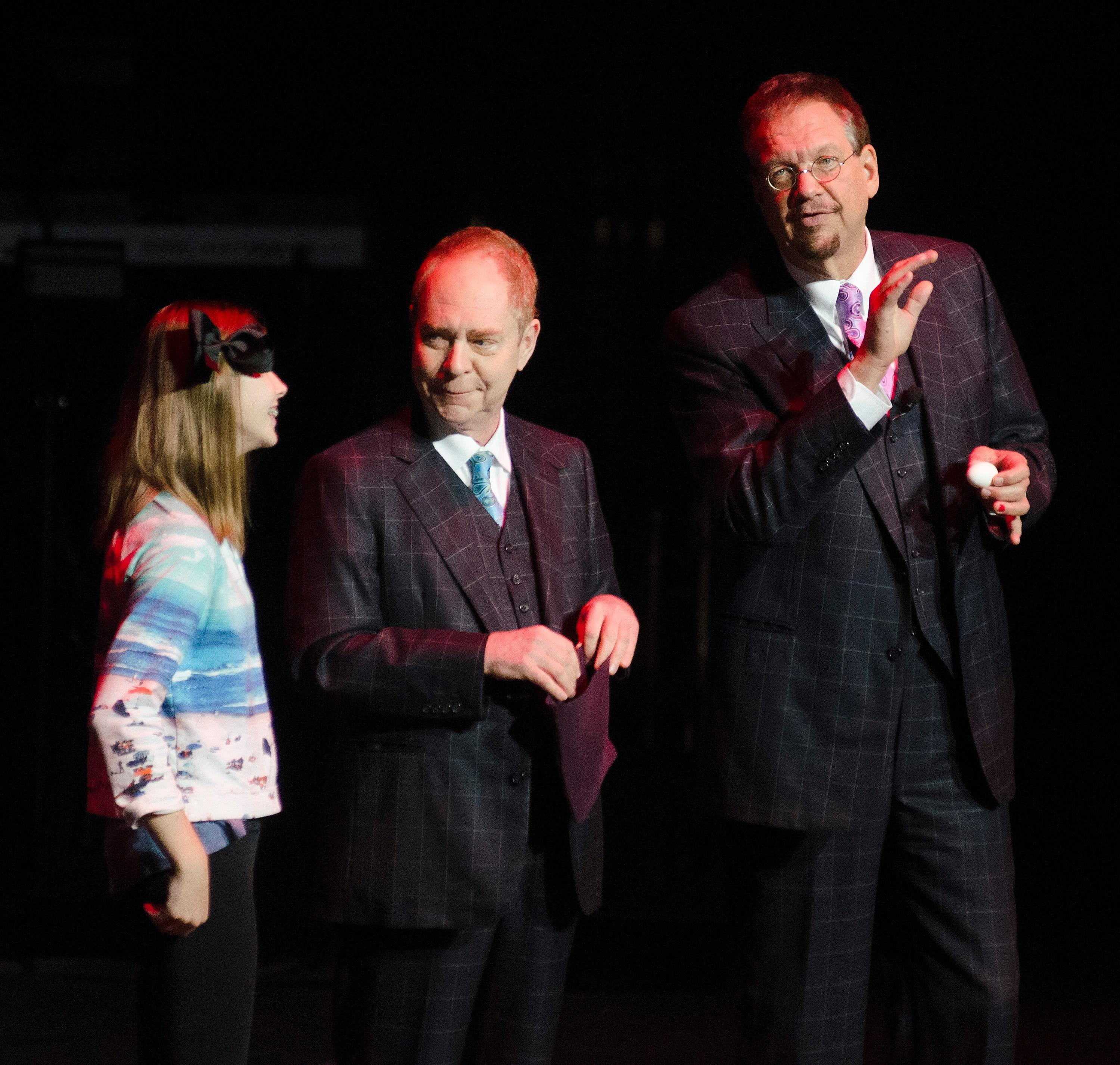 "Penn, right, and Teller, center, perform a magic trick with an audience member during the ""Vegas Cares"" benefit concert at the Venetian Theatre in the Venetian hotel-casino at 3355 S. Las Vegas Blvd in Las Vegas on Sunday, Nov 5, 2017. The concert was sponsored by a group of Las Vegas entertainers, producers and business professionals to honor the victims and first responders from the 1 October shooting tragedy. CREDIT: Bill Hughes/Las Vegas News Bureau"
