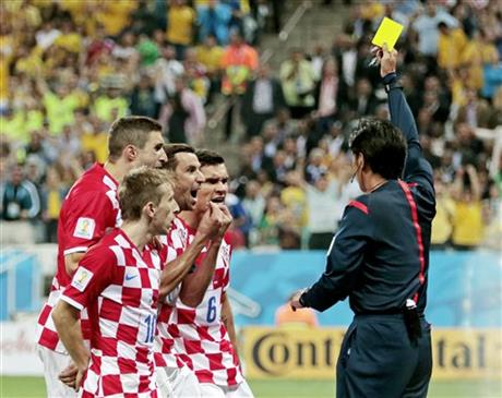 Croatia players argue after being given a penalty by referee Yuichi Nishimura from Japan during the group A World Cup soccer match between Brazil and Croatia.