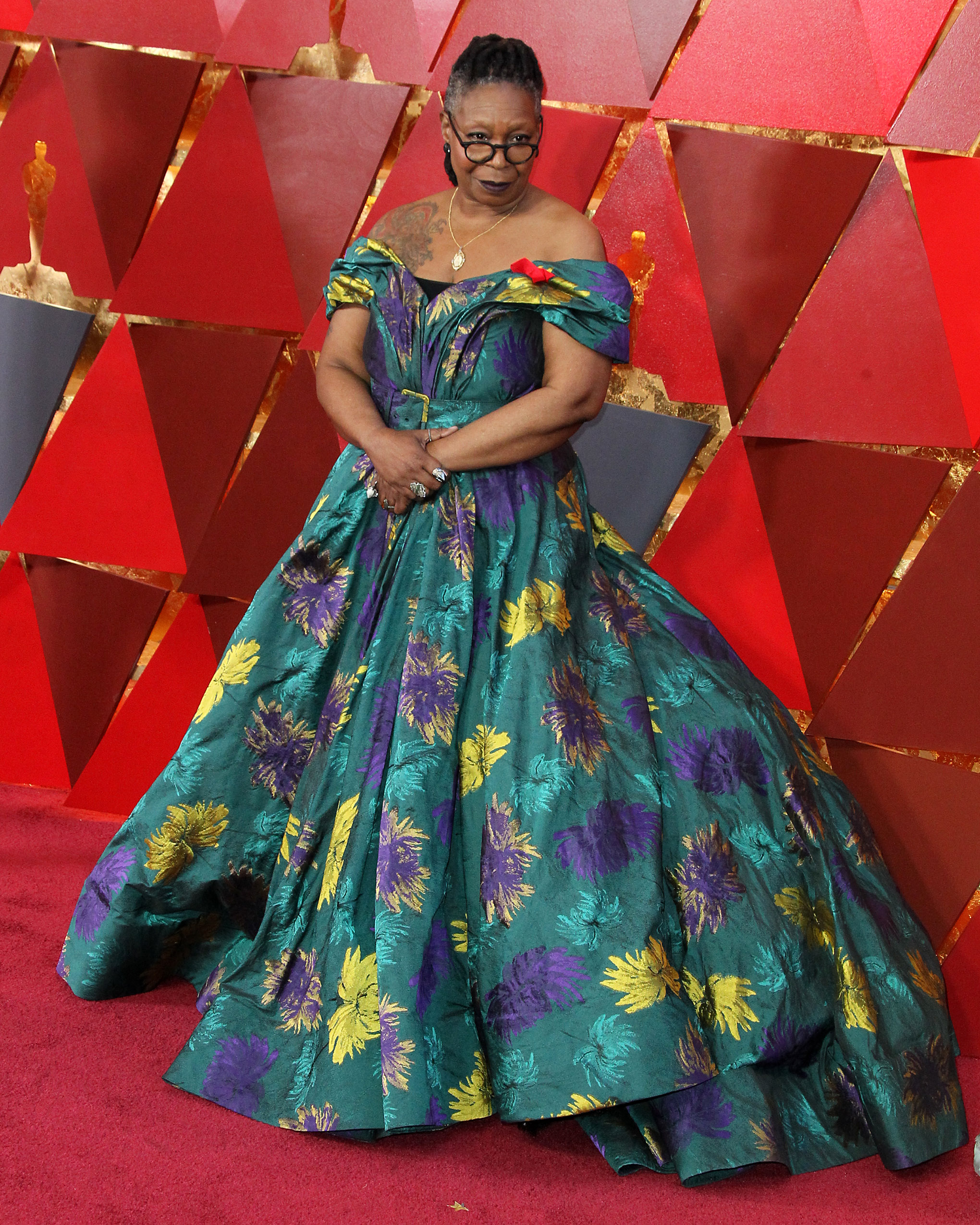 I loved the silhouette and color of this dress on Whoopi (and LOVE that it shows off her bada$$ tattoo), but the outdated florals were a no for me. (Image: Adriana M. Barraza/WENN.com)<p></p>