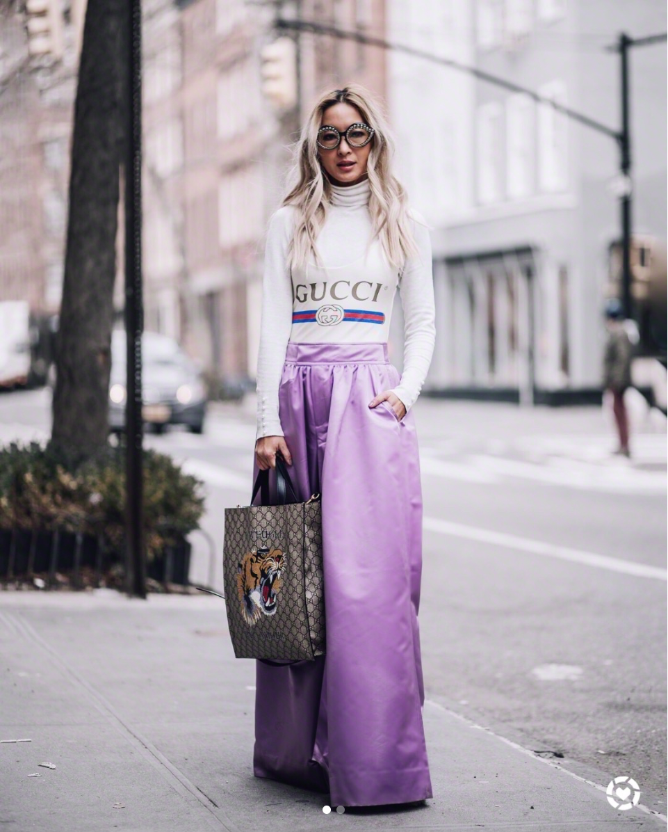 This look absolutely belongs at NYFW - it's punchy, but elevated. We love the lilac of  Anchyi's skirt tied to her fun Gucci sweater. (Image via @anchyi, photo by @bekahimagery)<p></p>