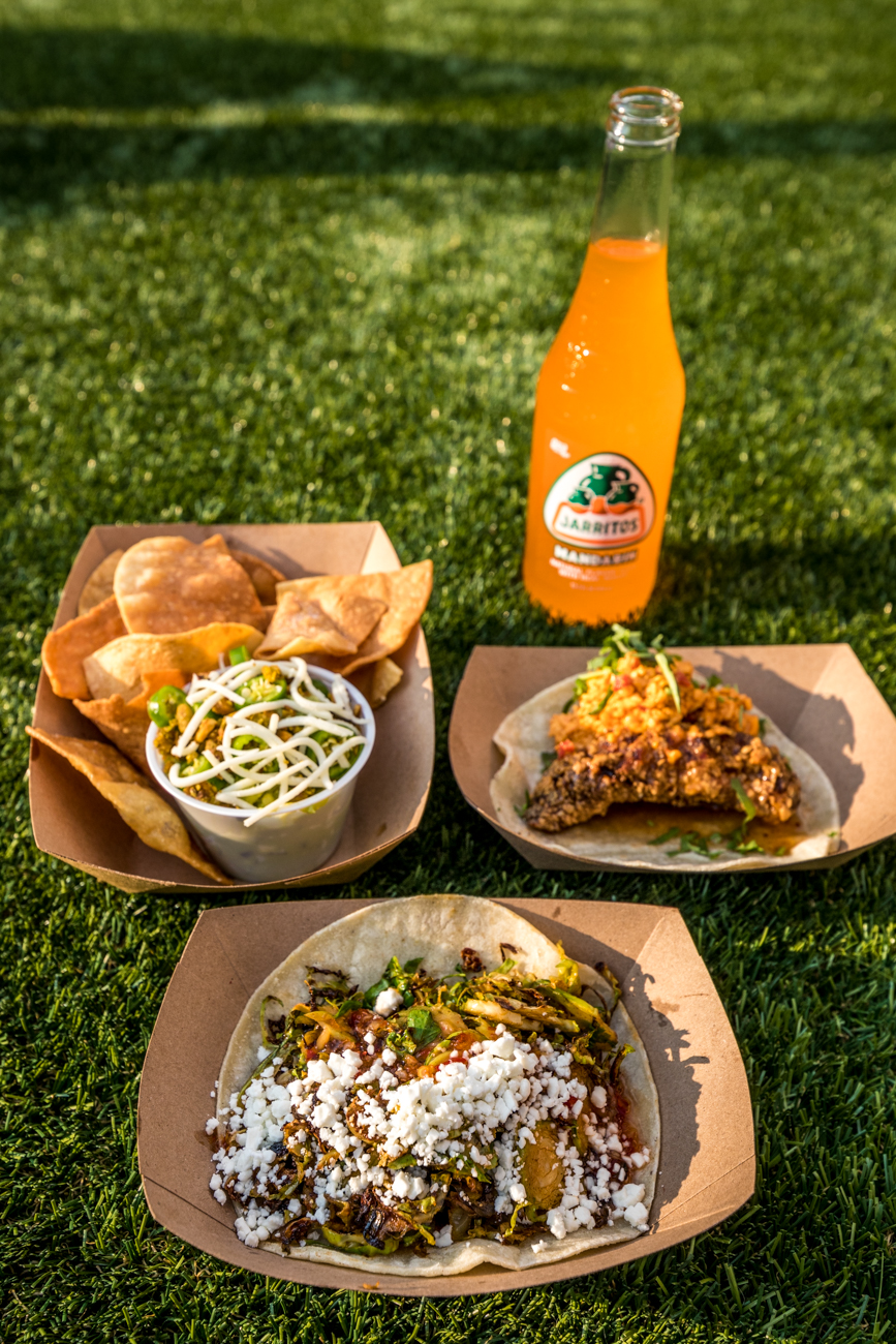 The Fried Chicken Taco (buttermilk fried chicken, house pimento cheese, and chipotle honey) and the Brussel Sprout Taco (brussel sprouts, sesame chili oil, chili garlic, and goat cheese) and chips with guacamole from Django Western Taco / Image: Catherine Viox{ }// Published: 10.15.20