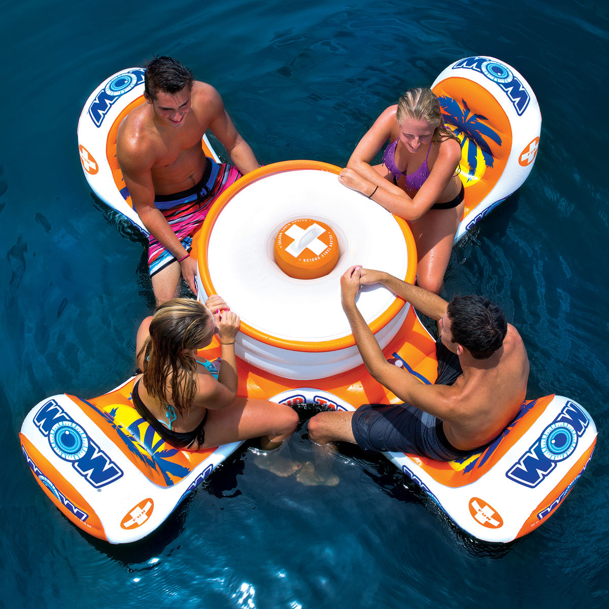 Floating Island Table: If you're looking to take care of business, but still have a good time why not spring for this inflatable. What will you do while seated at this four seater in the middle of the pool? Well really, the options are endless. This floatie is on sale at Overton's right now for $139.98. (Photo: Courtesy Overtons)