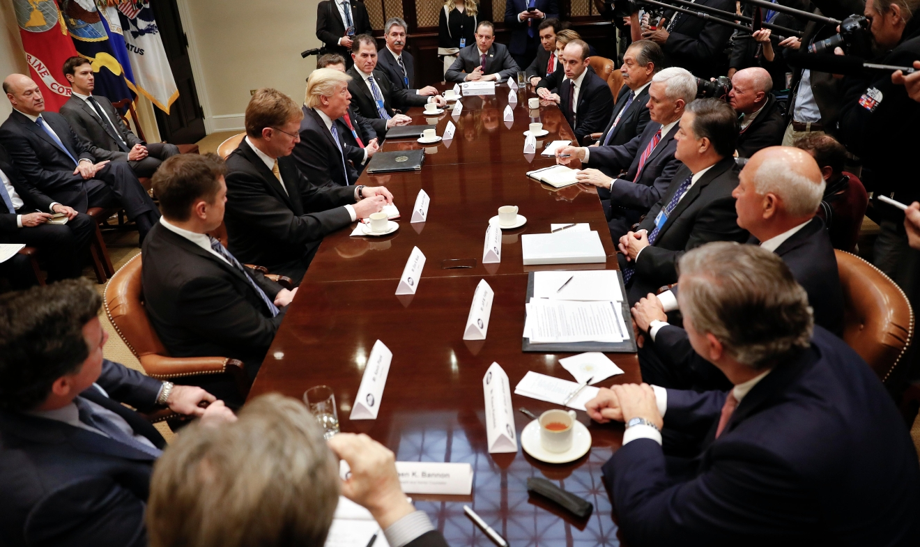 President Donald Trump, left center, host breakfast with business leaders in the Roosevelt Room of the White House in Washington, Monday, Jan. 23, 2017. At the meeting starting from the top going clockwise, White House Chief of Staff Reince Priebus, Mark Fields from Ford Motor Company, Marillyn A. Hewson from Lockhead Martin, White House Policy Adviser Stephen Miller, Andrew Liveris from Dow Chemicals, Vice President Mike Pence, Mark Sutton from International Paper, Jeff Fettig from Whirlpool, Klaus Kleinfeld from Arconic, White House Senior Adviser Steve Bannon, left, Kevin Plank from Under Armour, Elon Musk from Telsa and SpaceX, Wendell P. Weeks from Corning, President Trump, Alex Gorsky from Johnson & Johnson, Michael S. Dell from Dell Technologies and Mario Longhi from US Steel. (AP Photo/Pablo Martinez Monsivais)