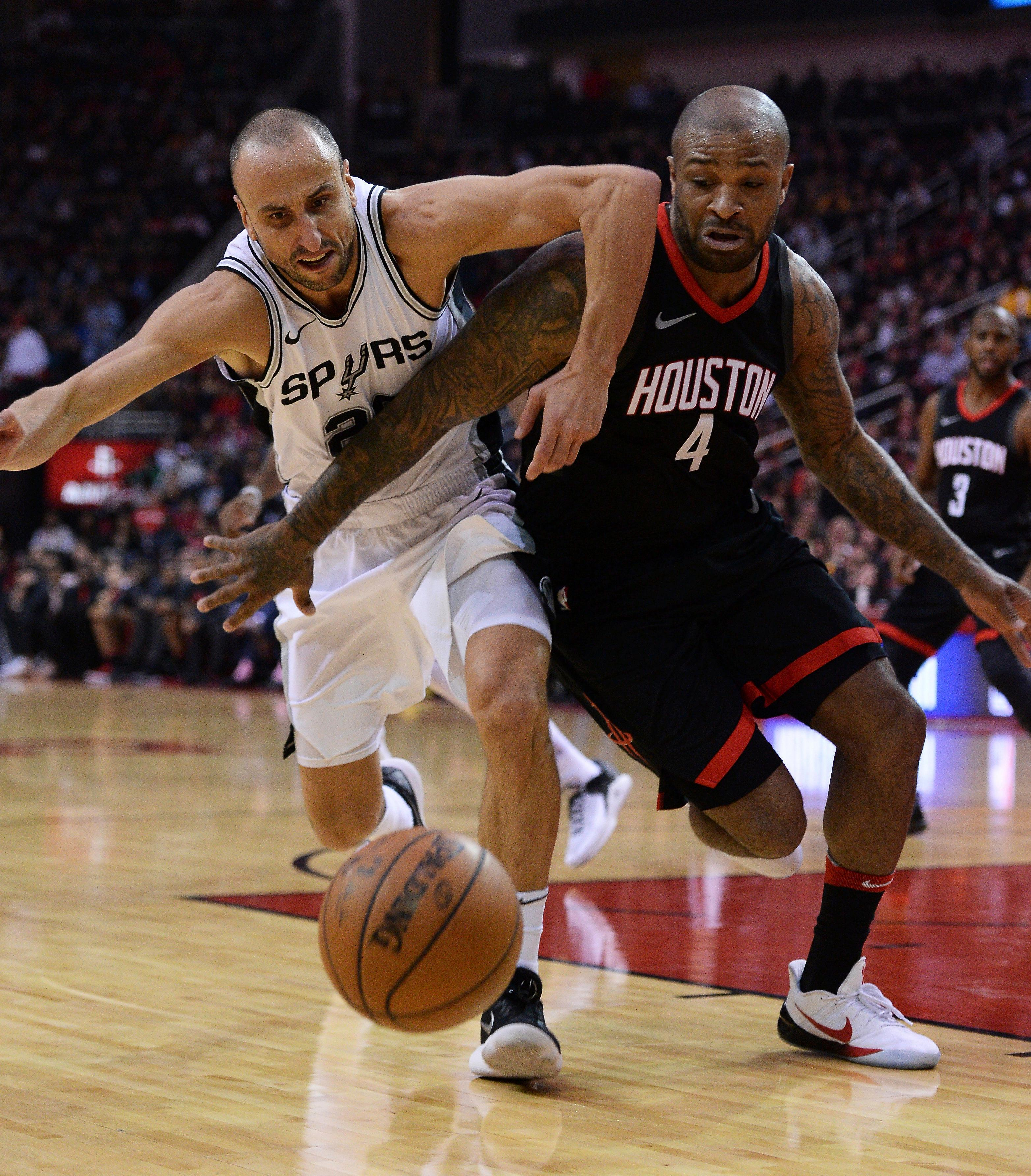 San Antonio Spurs guard Manu Ginobili, left, and Houston Rockets forward P.J. Tucker (4) battle for the ball in the first half of an NBA basketball game Friday, Dec. 15, 2017, in Houston. (AP Photo/George Bridges)
