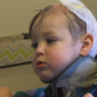 Toddler attacked by dog returns home in need of help