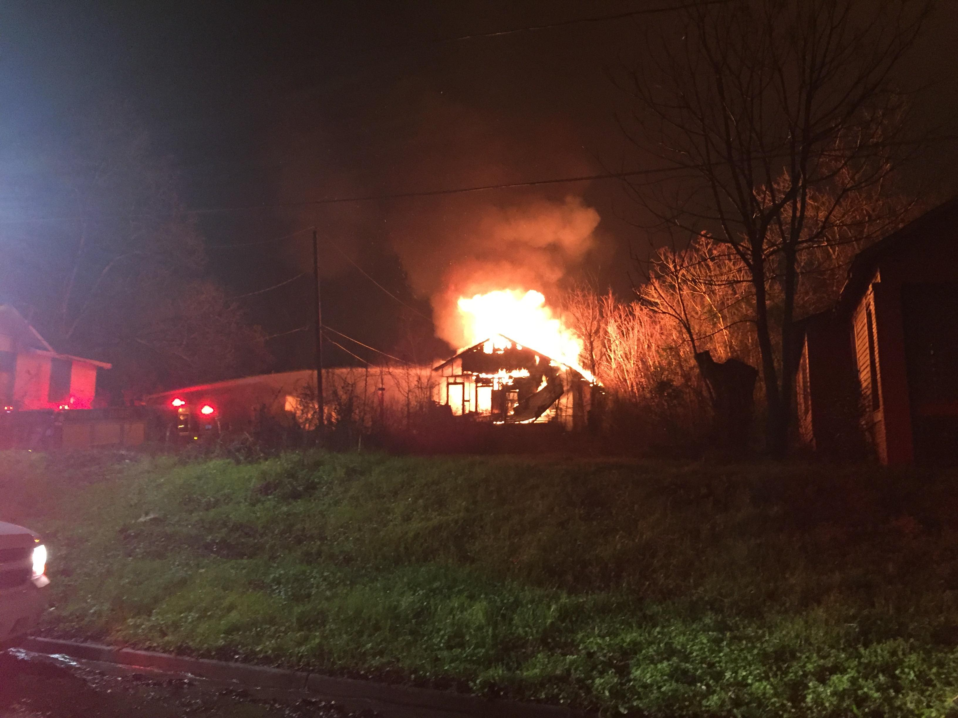 Firefighters battled this house fire on Calhoun St. and Edgewood Ave. Thursday night in Bibb County./David Domingue, WGXA News