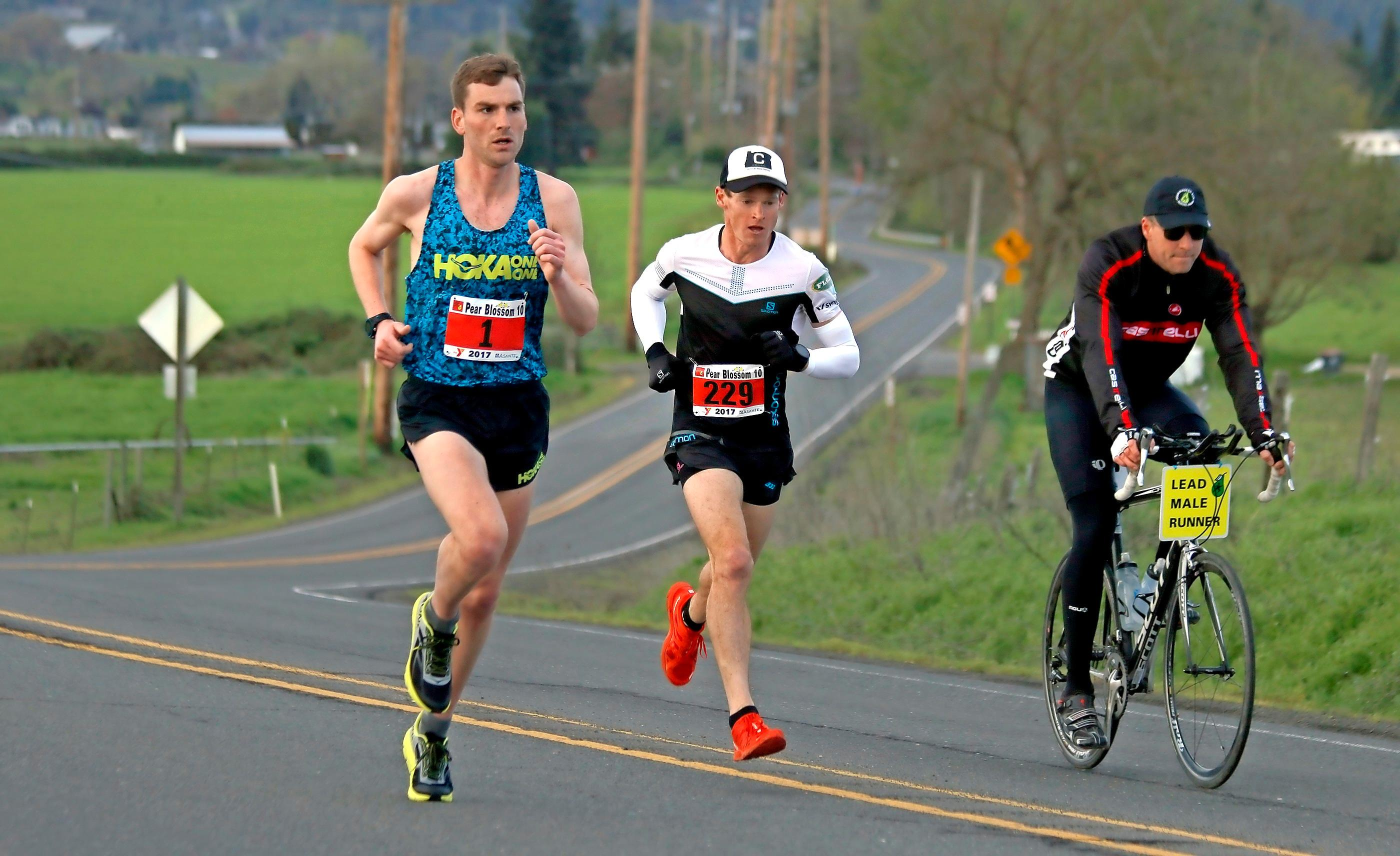 Andy Atkinson / MT File Photo Cole Watson (#1) and Max King run side-by-side heading to the turnaround past Hanley Hill during the 2017 Pear Blossom 10-mile run.
