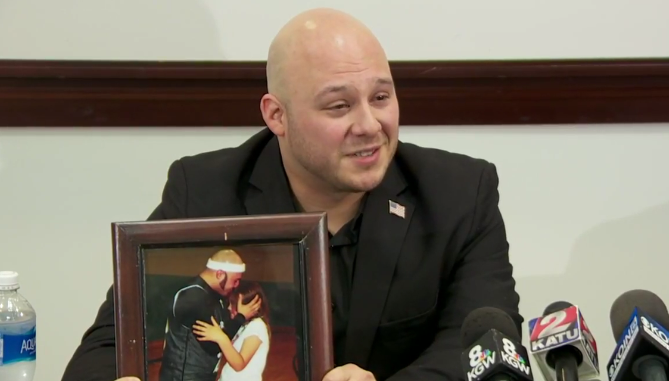 Rick Vaughan displays a photo of himself and his daughter during an interview on Nov. 10, 2017 (KATU News photo)