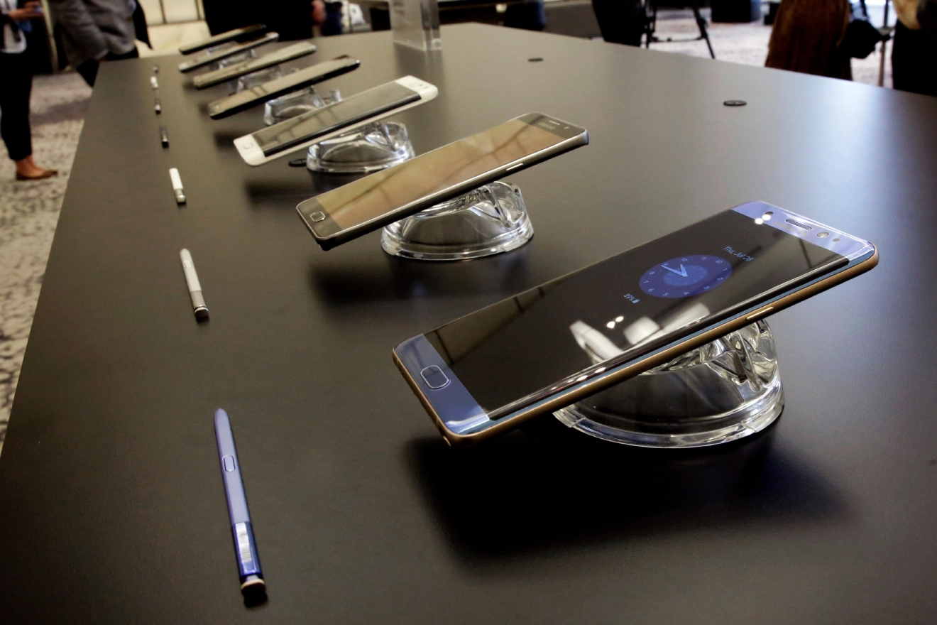 FILE - In this July 28, 2016, file photo, the Galaxy Note 7, foreground, is displayed in New York. In a statement issued Friday, Sept. 9, 2016, the U.S.  Consumer Product Safety Commission said owners of the Galaxy Note 7 smartphones should turn them off and stop using them because of the risk that their batteries can explode. (AP Photo/Richard Drew, File)