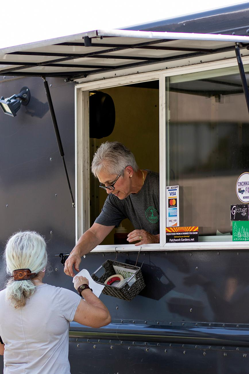 Lin Sartin, owner Patrick's mother, helps out on the food truck. / Image: Allison McAdams // Published: 8.12.19