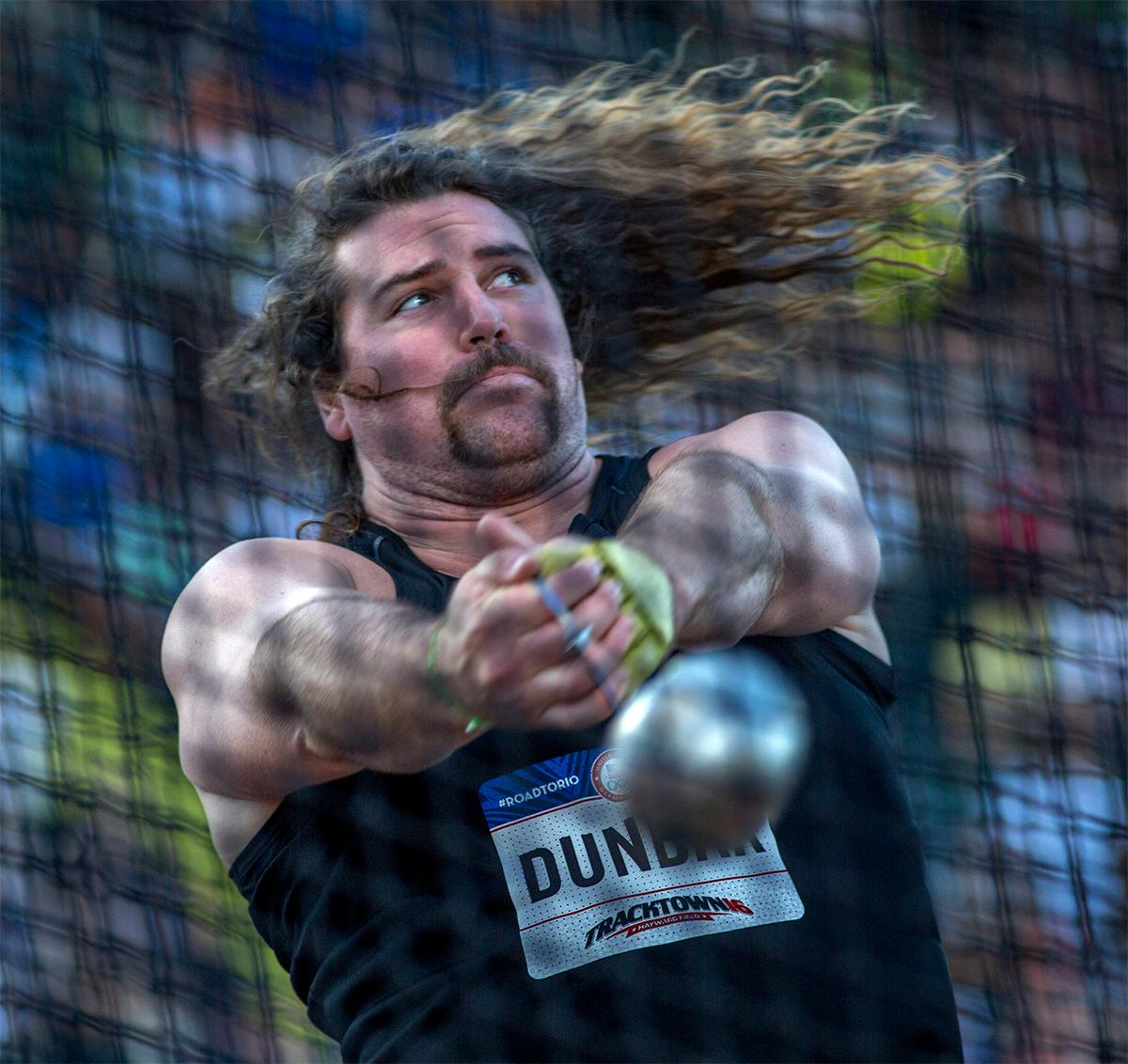 Colin Dunbar's locks flew along with the hammer on Wednesday, July 6. Photo by August Frank, Oregon News Lab