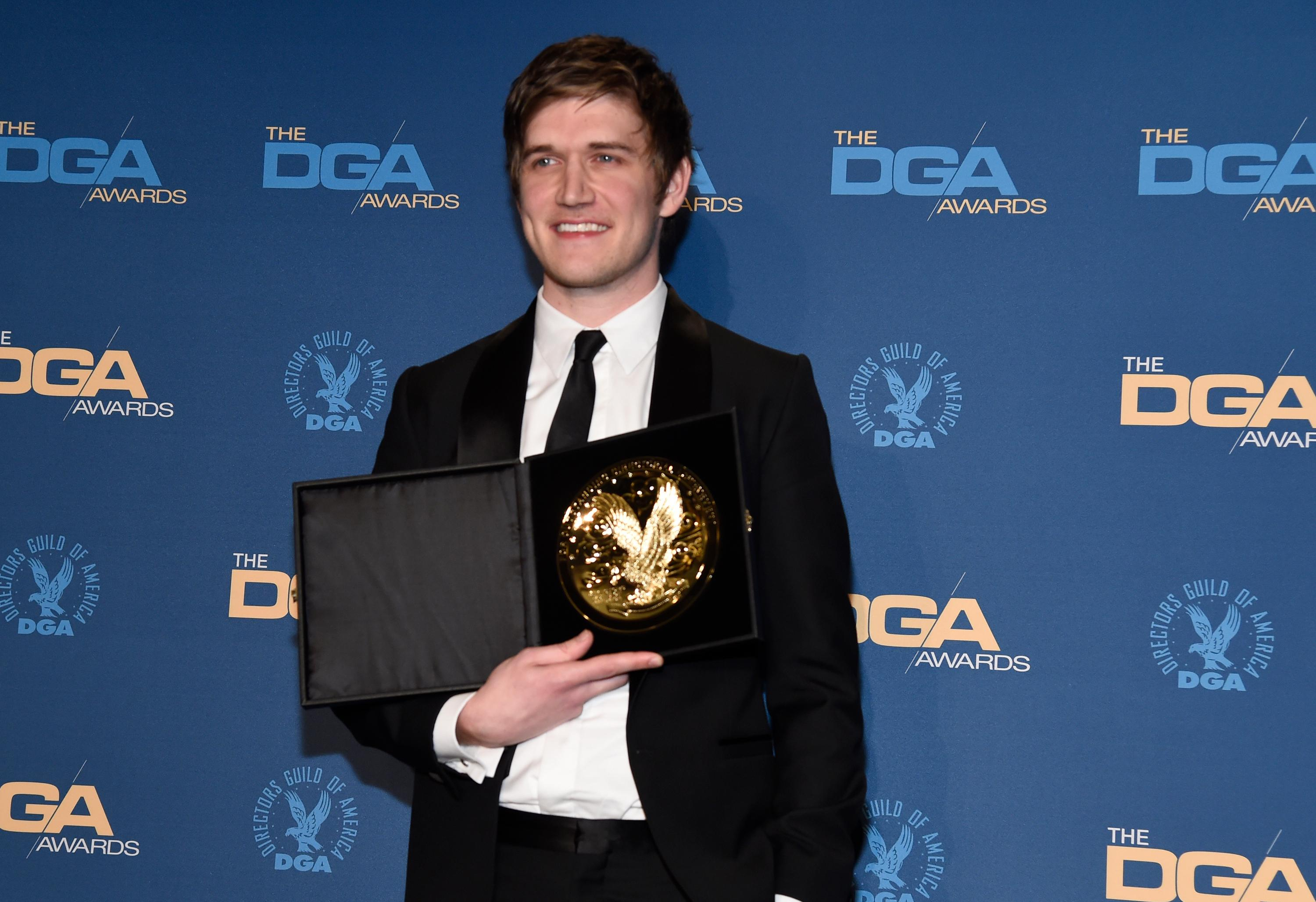 "Bo Burnham poses in the press room with the award for outstanding directorial achievement of a first-time feature film for ""Eighth Grade"" at the 71st annual DGA Awards at the Ray Dolby Ballroom on Saturday, Feb. 2, 2019, in Los Angeles. (Photo by Chris Pizzello/Invision/AP)"