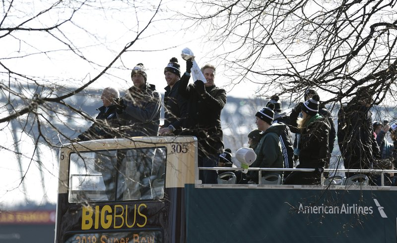 <p>Philadelphia Eagles NFL football head coach Doug Pederson holds up the Vince Lombardi trophy during the Super Bowl LII victory parade, Thursday, Feb 8, 2018, in Philadelphia. From left are Eagles owner Jeffrey Lurie, quarterbacks Nick Foles and Carson Wentz and coach Pederson. (AP Photo/Michael Perez)</p>