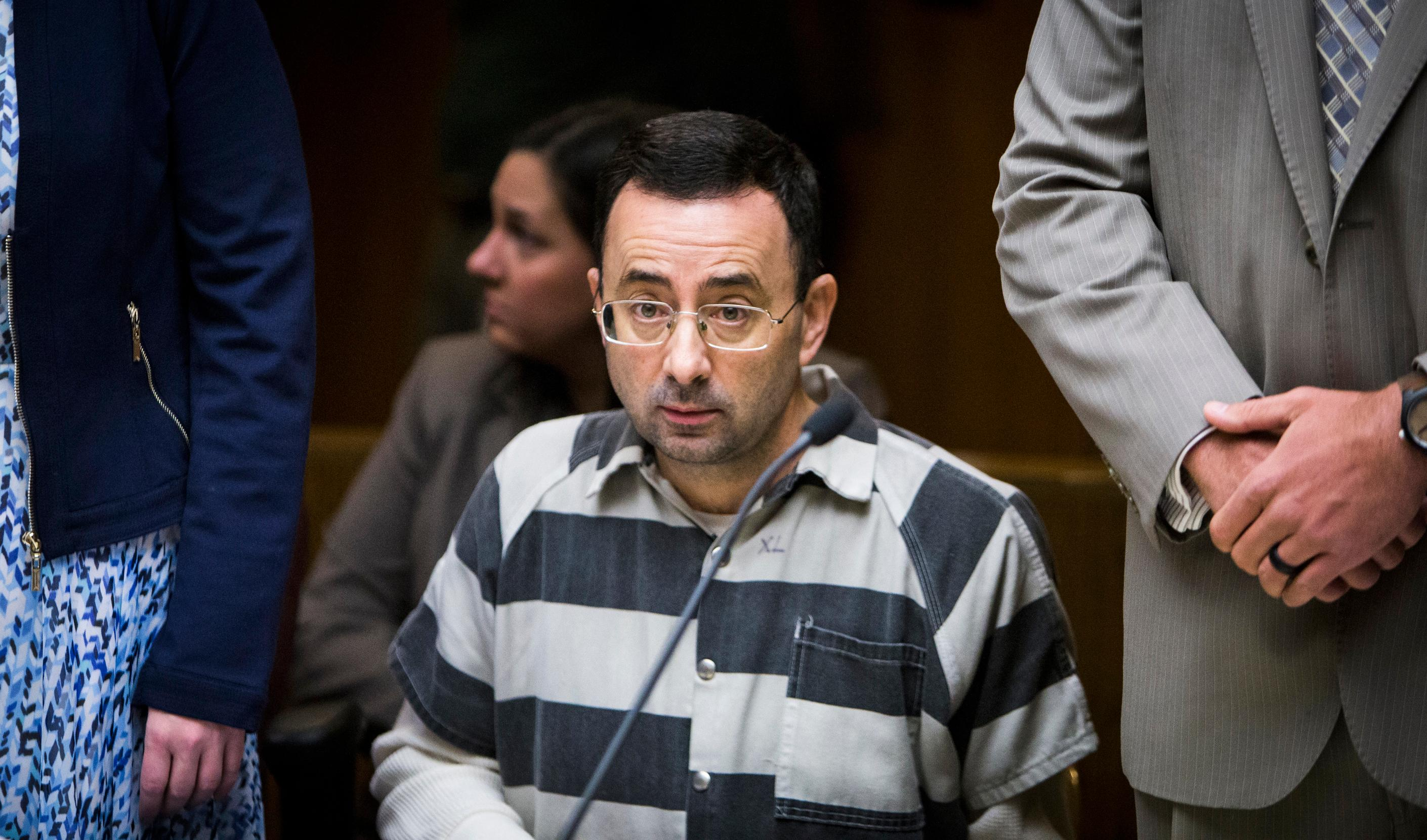Dr. Larry Nassar listens during a preliminary hearing Friday, May 12, 2017, in Mason, Mich.. Nassar, a former Michigan State University doctor who also worked for USA Gymnastics, faces sexual assault charges charges. (Matthew Dae Smith/Lansing State Journal via AP)
