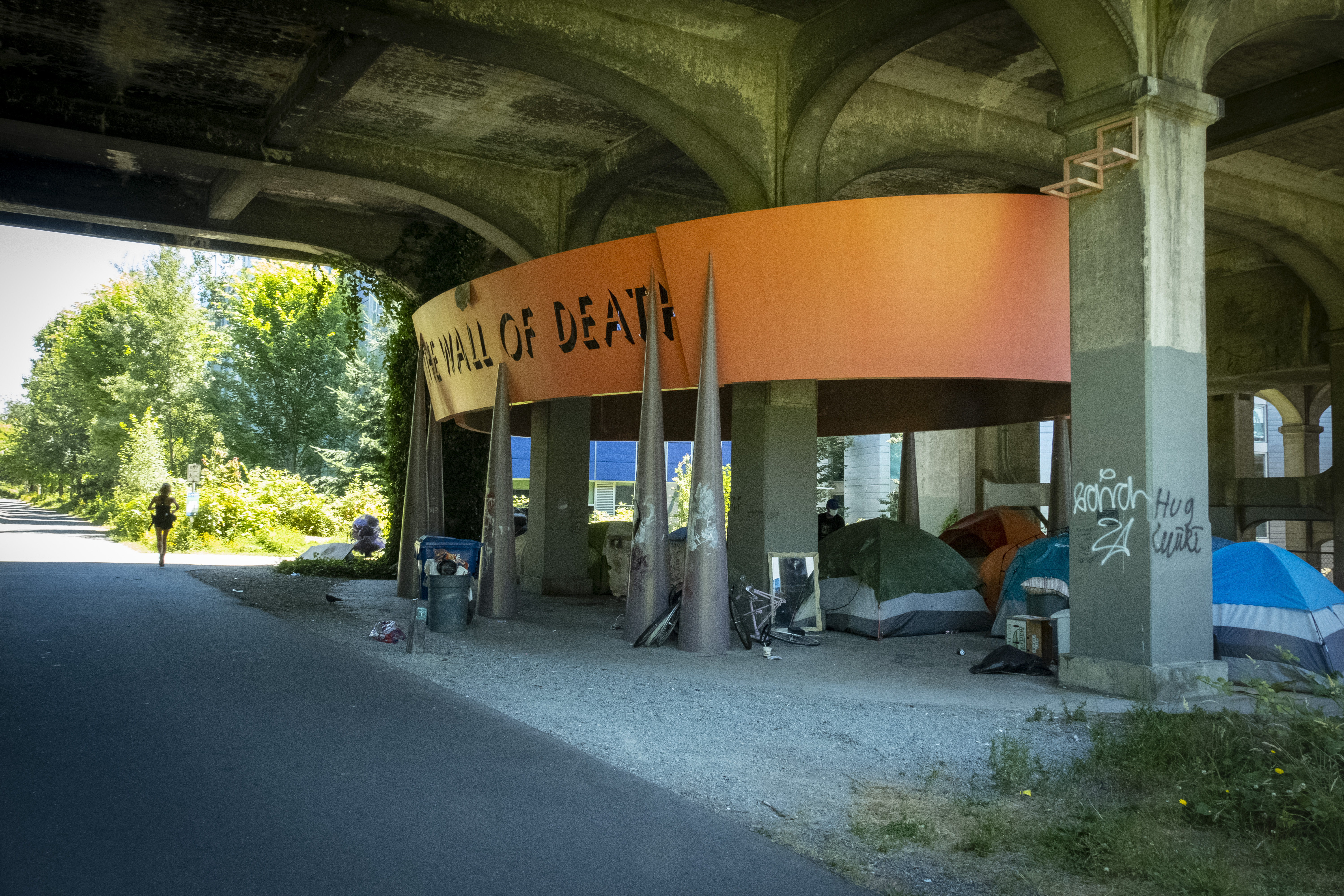 """Wall of Death"" - University Bridge & Burke Gilman Trail. Artists: Mowry Baden and Colin Baden .{ }Seattle is full of amazing artists doing amazing art. Some of the largest and most unusual pieces in the city are hidden in plain sight. So, take a stroll with us to discover some of Seattle's coolest public art displays. Some fresh air will do you good! (Image: John Prentice / Seattle Refined)"