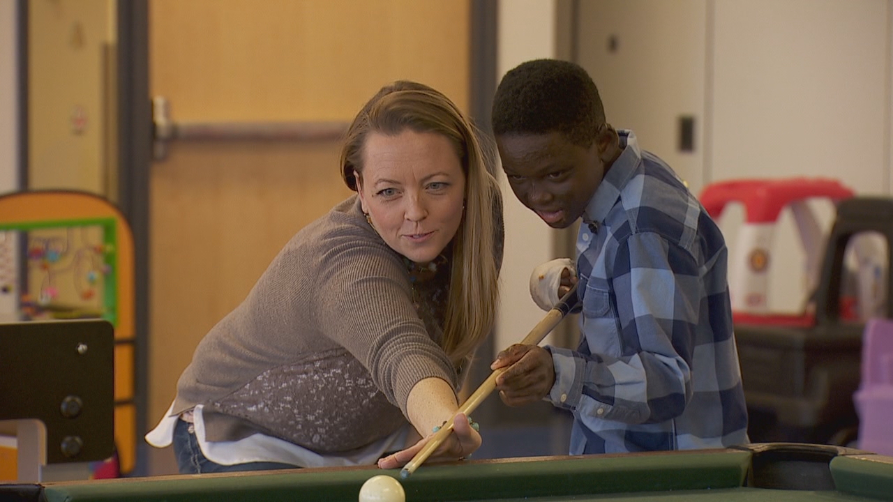 Elijah Anderson knows the game room at Shriners Hospital for Children, where between surgeries he's able to shoot pool, make goals at the foosball table and play video games. Here he sets up a shot with his host mom, Sarah Wagner. (KATU)<p></p>