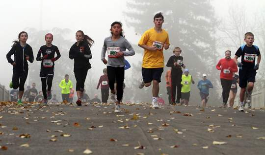 Turkey Trot 8-mile, 2-mile and 100 yard dash runs. Thanksgiving morning in Medford, 11/27/14. Andy Atkinson Photo