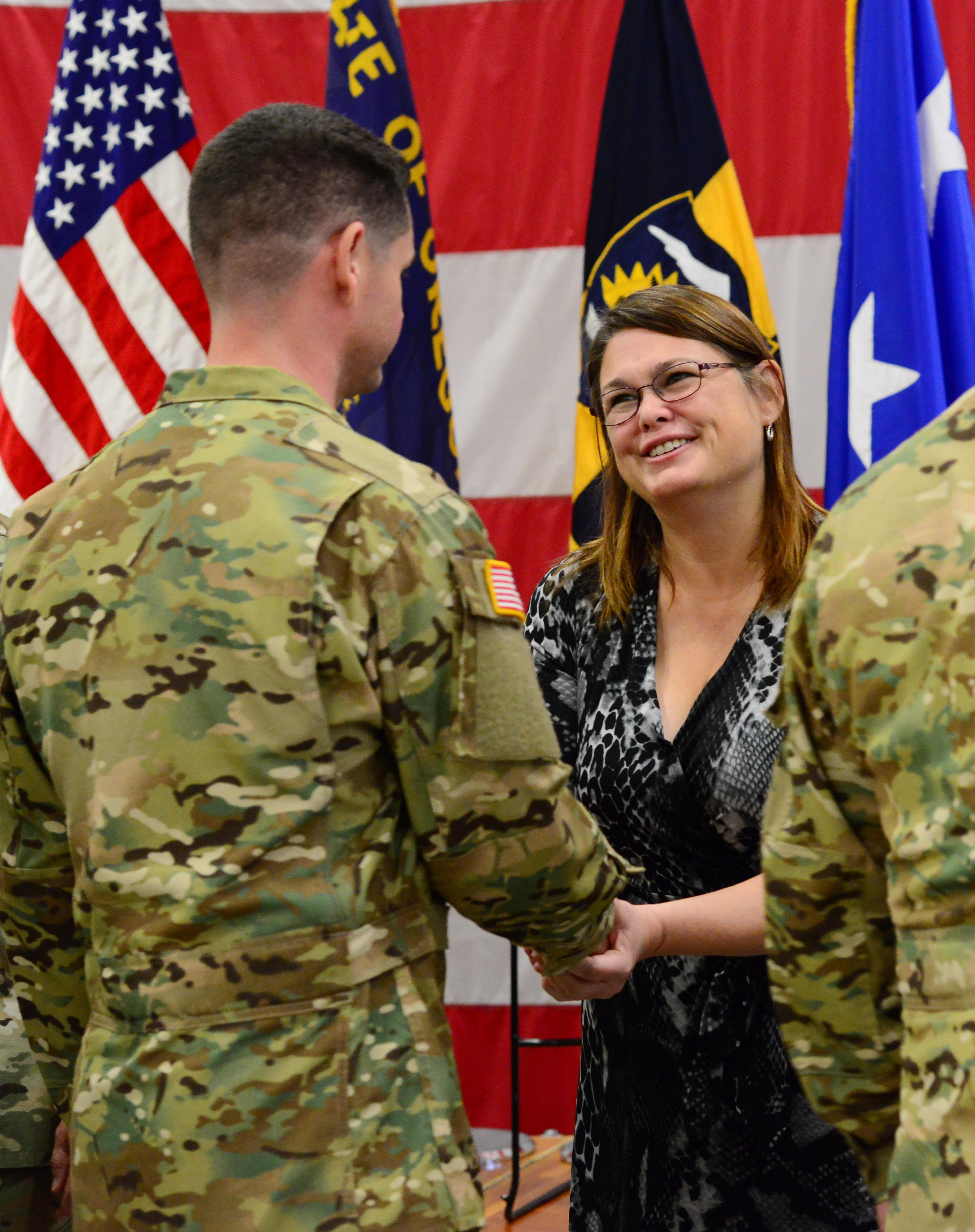 State Senator Sara Gelser greets Oregon Army National Guard Soldiers of Detachment 3, Company G, 1st Battalion, 189th Aviation Regiment, to wish them well on their overseas deployment during a mobilization ceremony, Sept. 29, 2017, in Salem, Oregon. A platoon of more than 20 Soldiers is scheduled to deploy to the Middle East to assist with aerial medical evacuation support using Black Hawk helicopters. They will be joining their parent unit, the South Dakota Army National Guard's Company C, 1-189th Aviation Battalion, in the Middle East and will be deployed for approximately one year. (Photo by Sgt. 1st Class April Davis, Oregon Military Department Public Affairs)