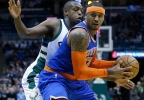 New York Knicks' Carmelo Anthony, right, looks to shoot while being defended by Milwaukee Bucks' Khris Middleton, left, Wednesday, March 8, 2017, in Milwaukee.