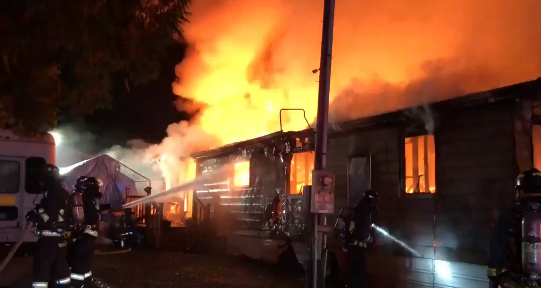 Firefighters work to douse a blaze at a Bonney Lake mobile home (East Pierce Fire & Rescue photo)