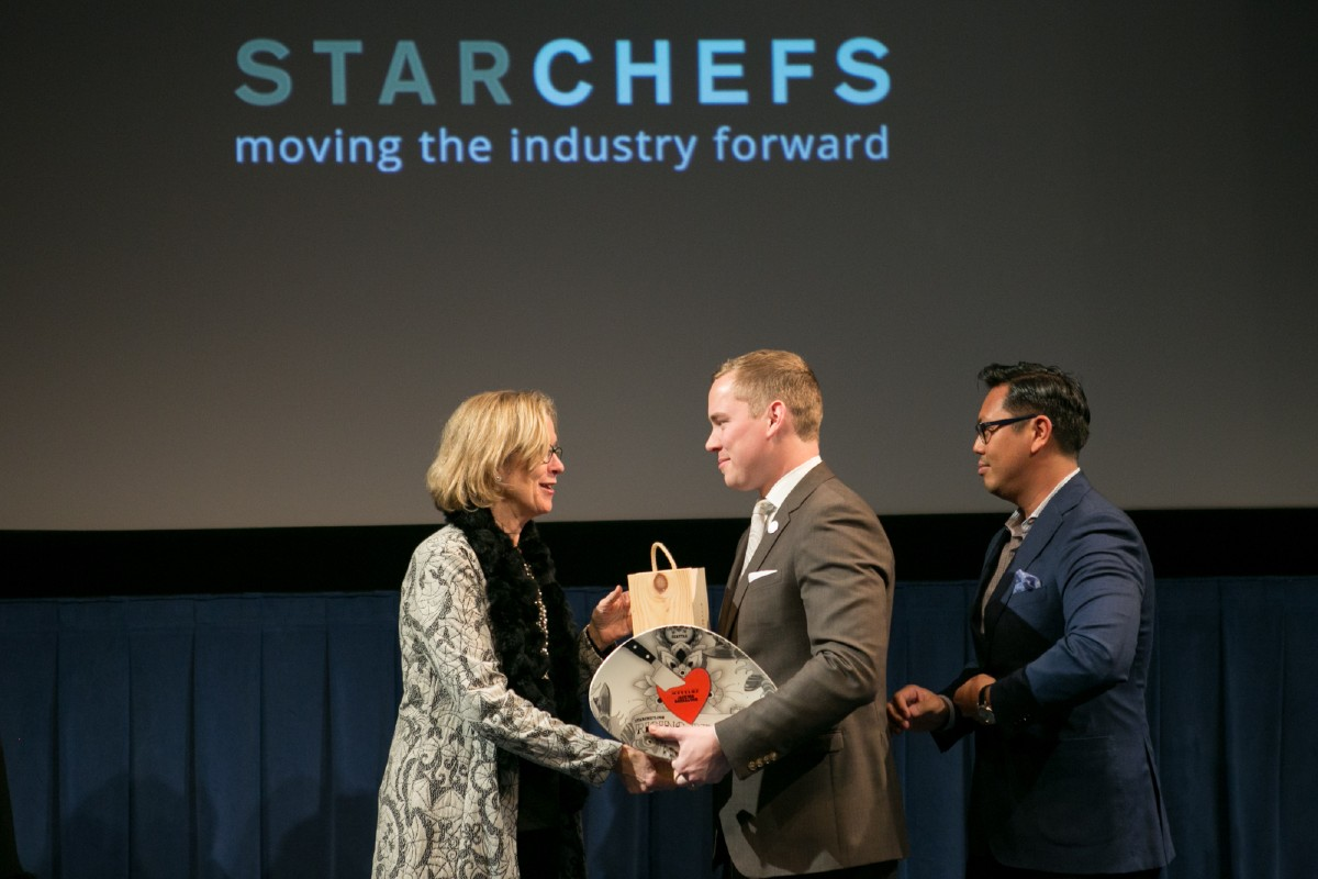 Jackson Rohrbaugh of Canlis accepting his Rising Star Sommelier award with Nelson Daquip of Canlis, Rising Star Sommelier in 2009. (Image: Design StarChefs)