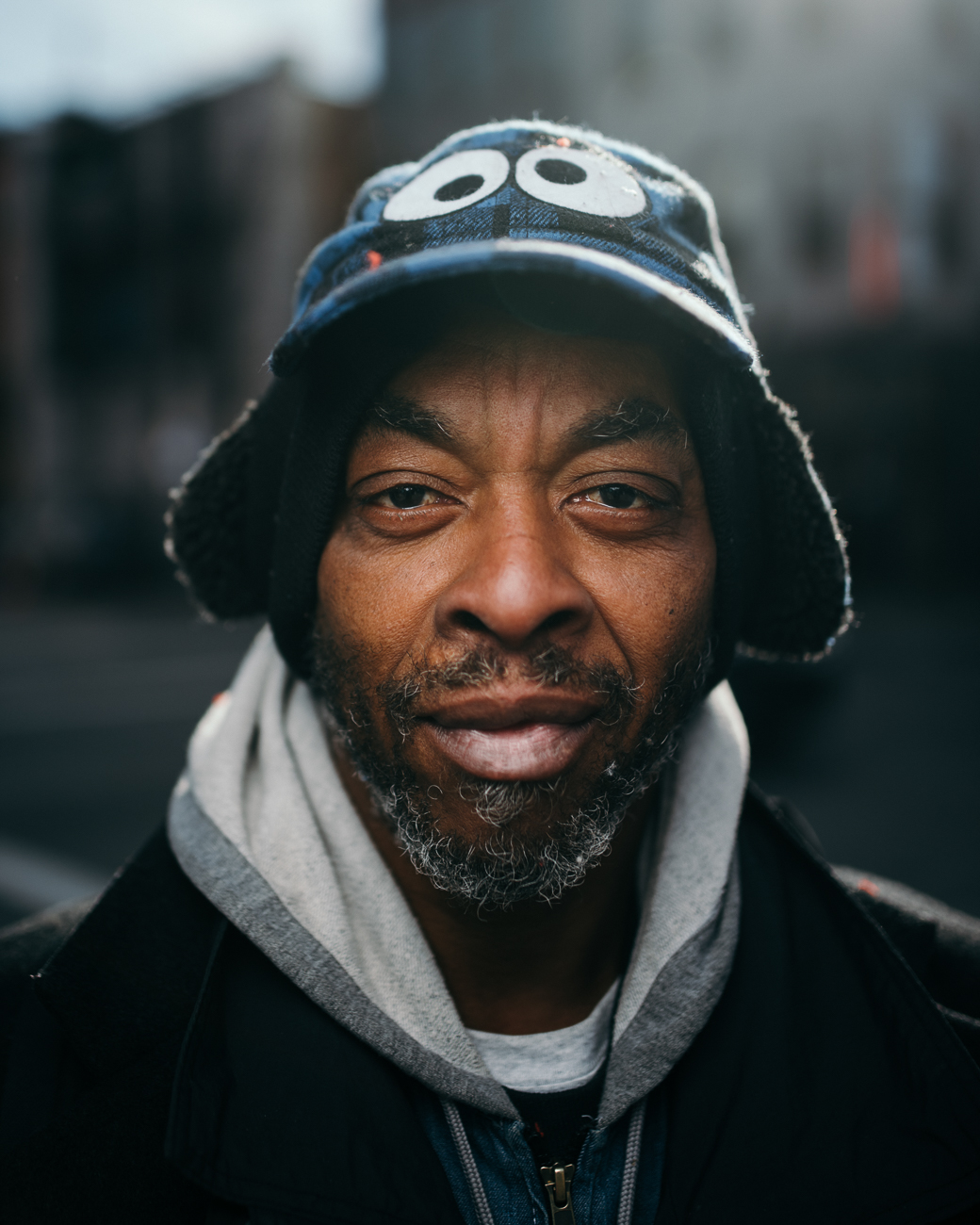 """Cincinnati, like most major cities, requires a permit to use a tripod or light stand on the ground. I decided to get around this rule by creating a device that allows me to carry my light on my back. I use it to capture very dramatic and unique portraits of people out on the street. You can follow the hashtag #gogogadgetoctobox to see some of the portraits I have taken."" / Image: Brendan Burkett // Published: 7.29.19"