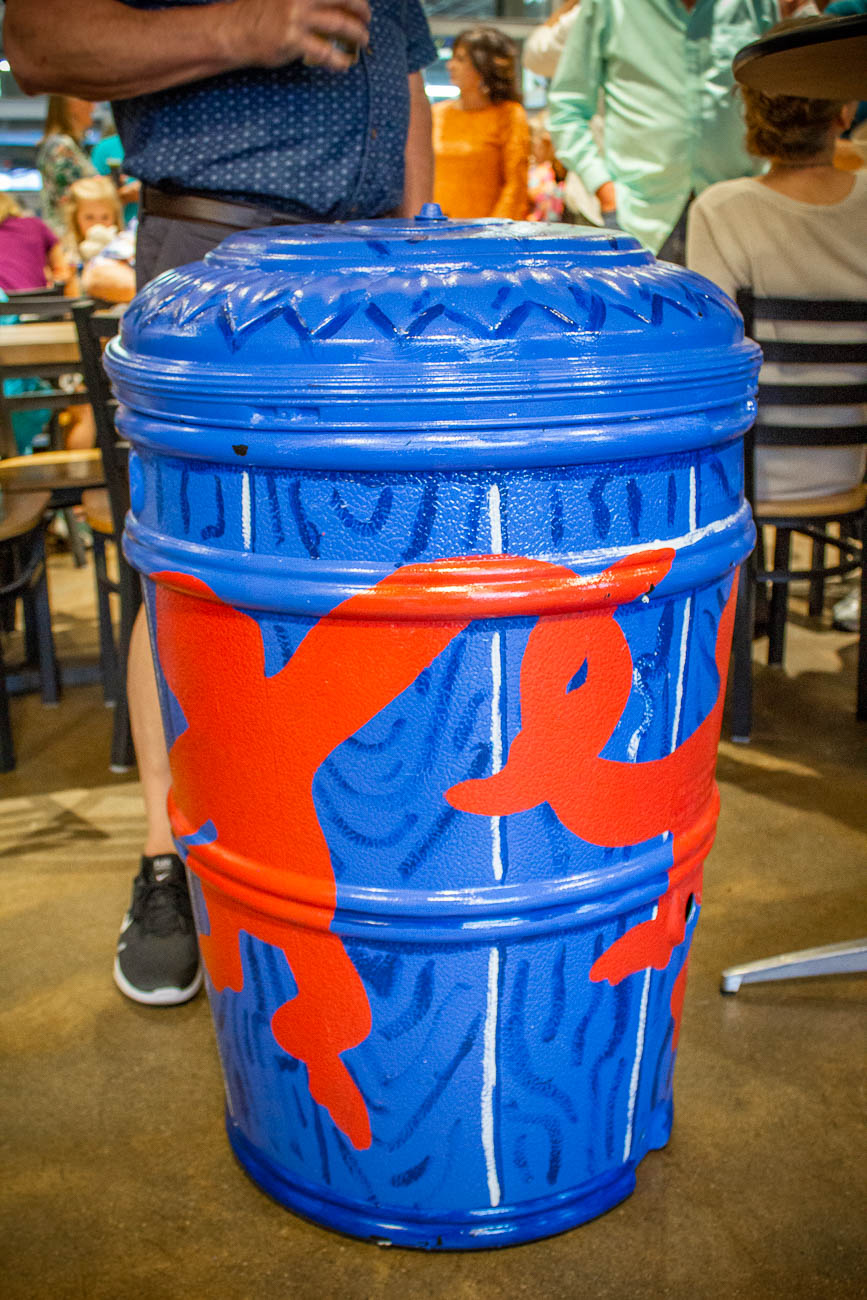 Greenline raffles off a decorated rain barrel every year for the event. It was designed by the Covington design agency, BLDG. Collecting rain helps to reduce surface runoff and can be used later to water plants. / Image: Katie Robinson, Cincinnati Refined // Published: 4.19.19