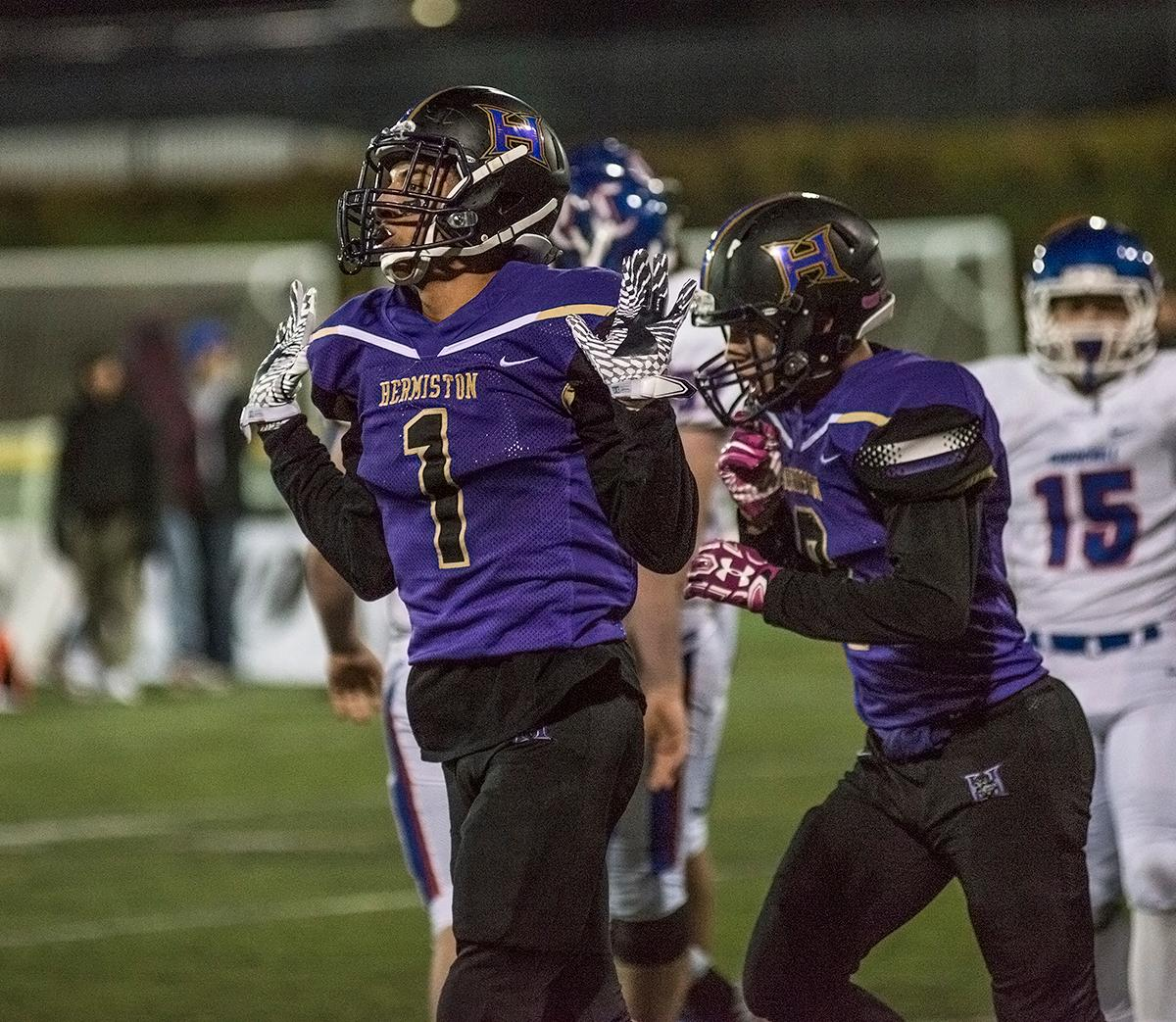 Hermiston Bulldogs wide receiver Dayshawn Neal (#1) celebrates a touchdown.The Hermiston Bulldogs defeated the Churchill Lancers 38-35 for the 5A state title Saturday evening at Hillsboro Stadium. Photo by Abigail Winn, Oregon News Lab