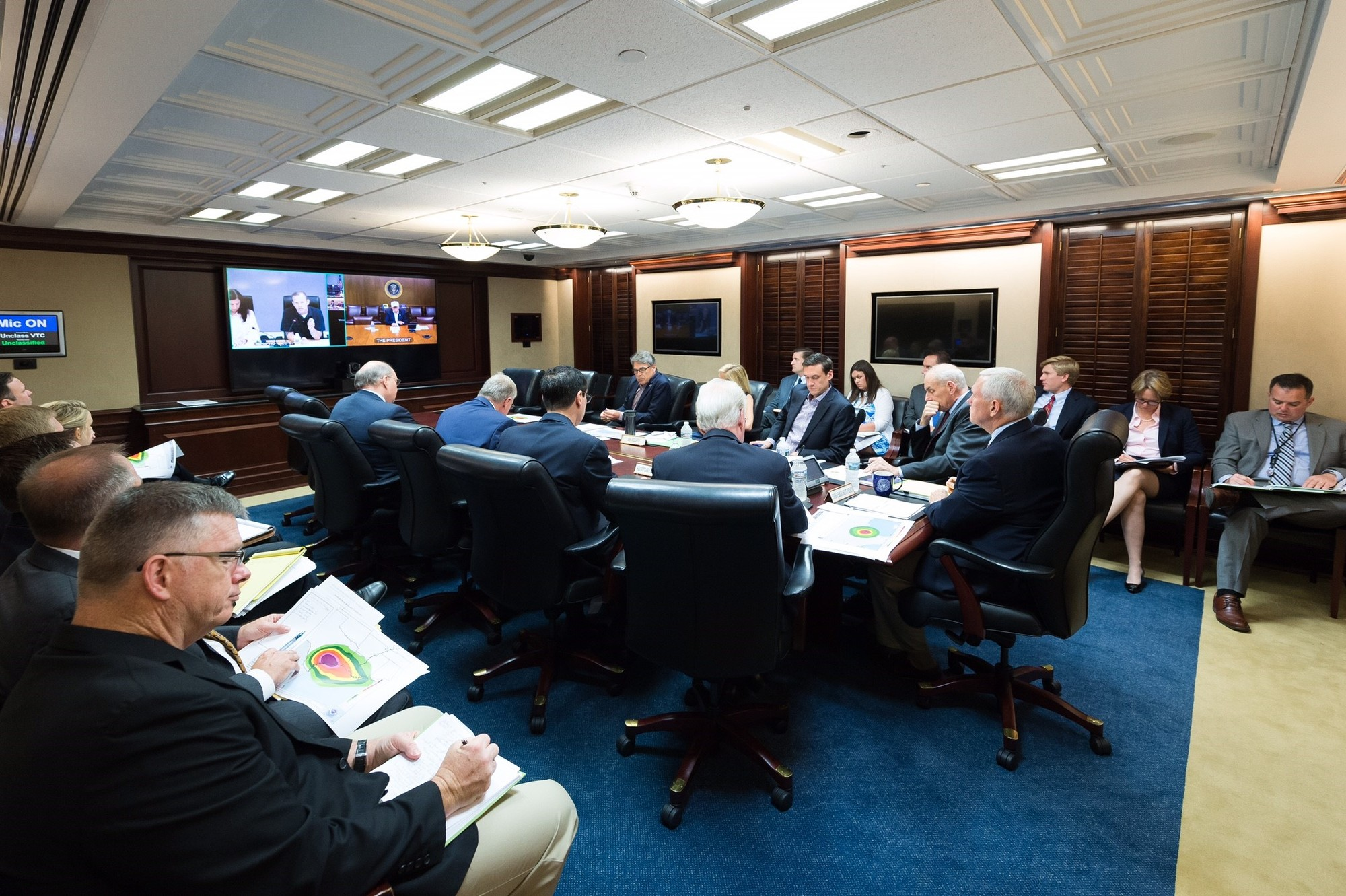 "President Donald J. Trump conducts a video teleconference on Hurricane Harvey, Saturday, August 26, 2017, from Camp David, Confers with Vice President Mike Pence; Chief of Staff Gen. John Kelly; Thomas Bossert, Homeland Security Advisor; Gen. Keith Kellogg, National Security Advisor Chief of Staff; Deputy Chief of Staff for White House Operations, Joe Hagin; Elaine Duke, Acting Secretary of the Department of Homeland Security; Health and Human Service Secretary Tom Price; U.S. Secretary of Energy Rick Perry; White House Deputy Chief of Staff Kirstjen Nielsen and William B. ""Brock"" Long, Administrator of FEMA. (Official White House Photo by Andrea Hanks)?"