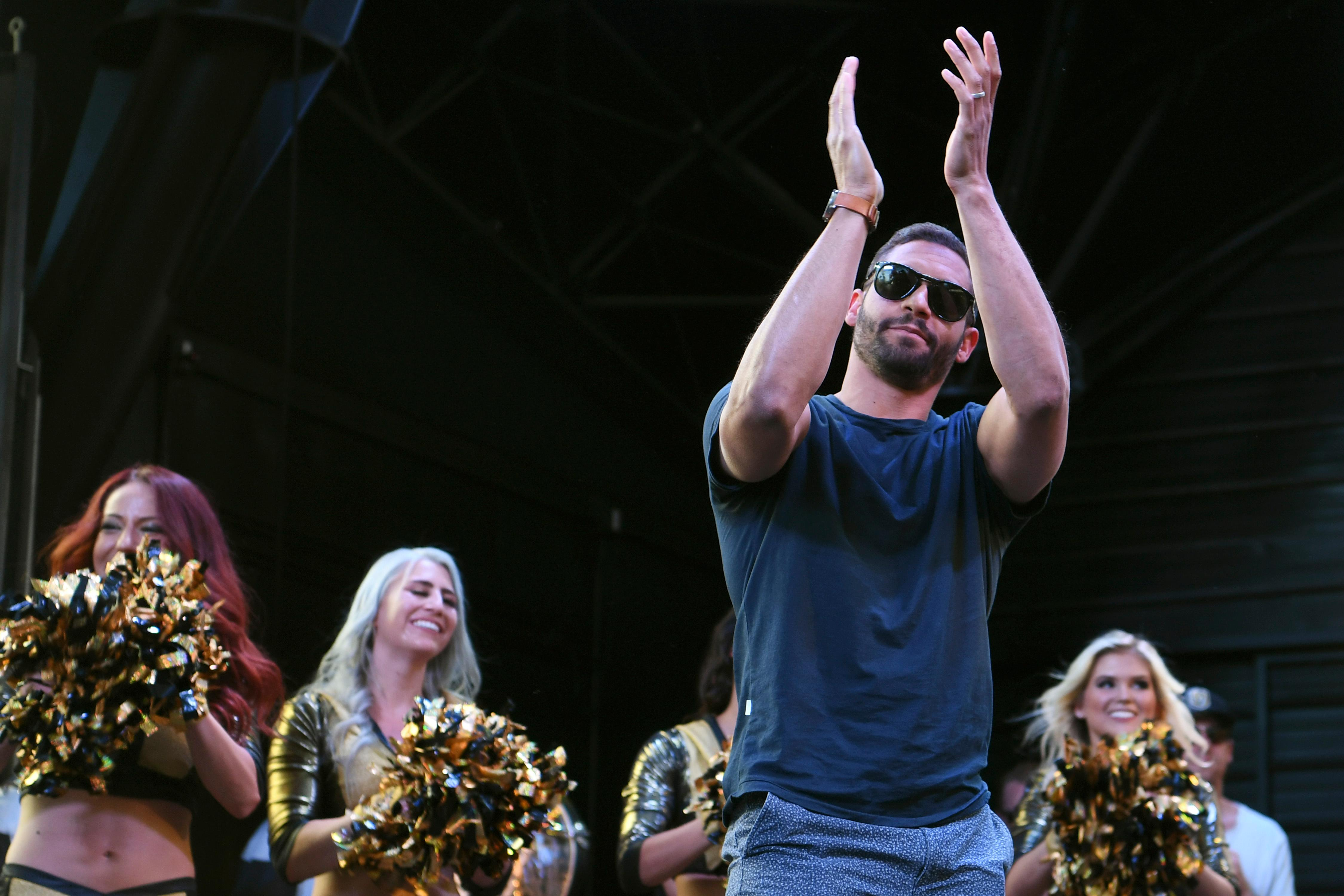 Vegas Golden Knights left wing Pierre-Edouard Bellemare salutes the estimated crowd of 7,500 people during a Vegas Golden Knights Stick Salute to Vegas fan appreciation rally at the Fremont Street Experience Wednesday, June 13, 2018. CREDIT: Sam Morris/Las Vegas News Bureau