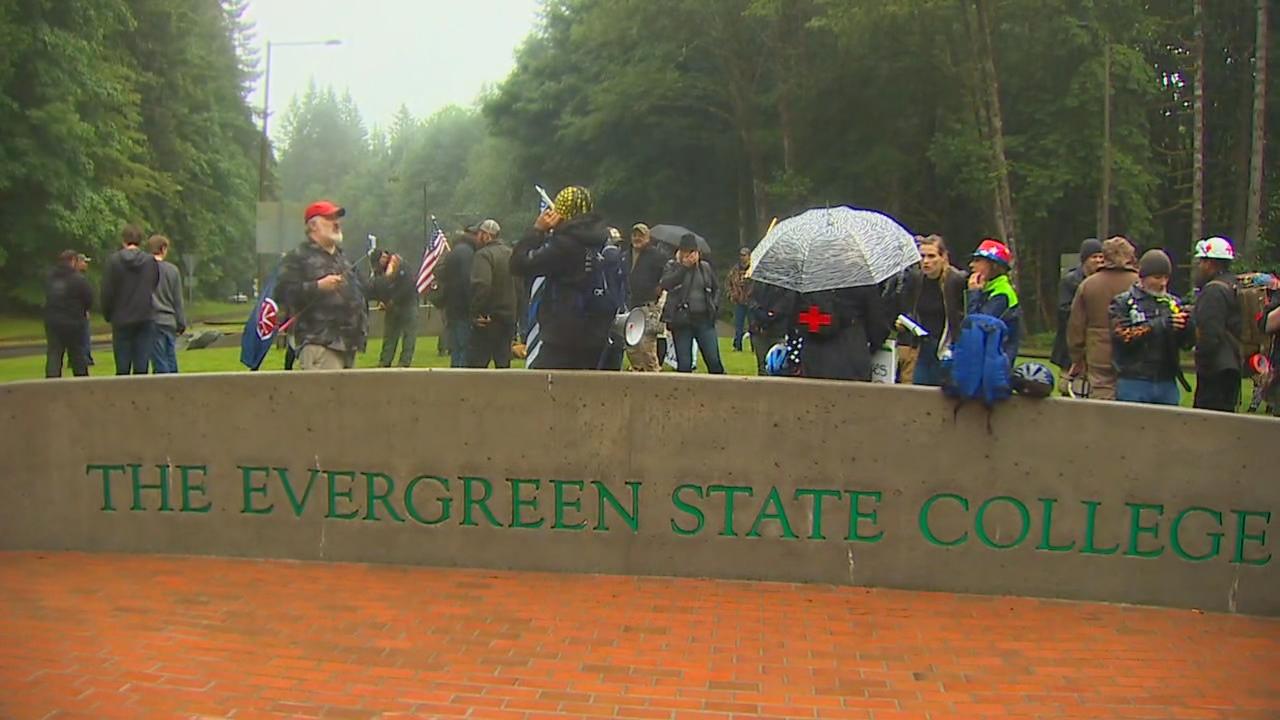 One person was arrested and at least two cars damaged, after demonstrators from a rally and competing protest clashed on the Evergreen State College campus in Olympia Thursday evening, according to the State Patrol. (Photo: KOMO News)