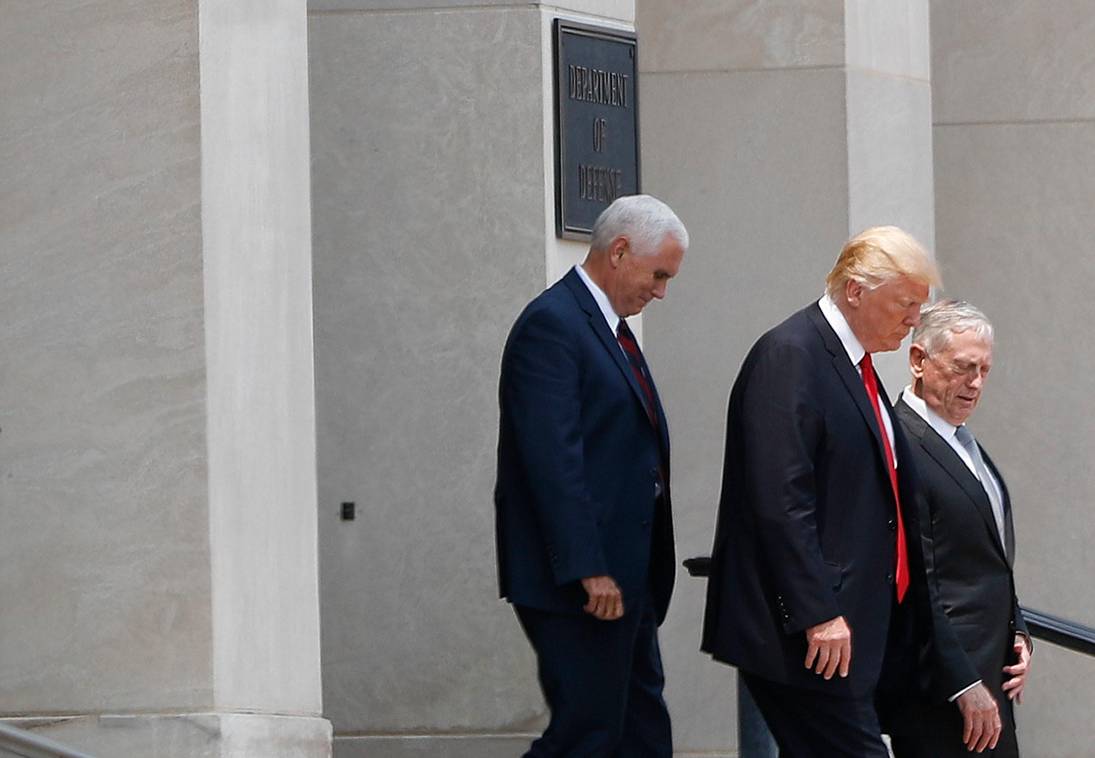 President Donald Trump and Vice President Mike Pence walk out with Defense Secretary Jim Mattis following Trump's visit to the Pentagon, Thursday, July 20, 2017. (AP Photo/Pablo Martinez Monsivais)