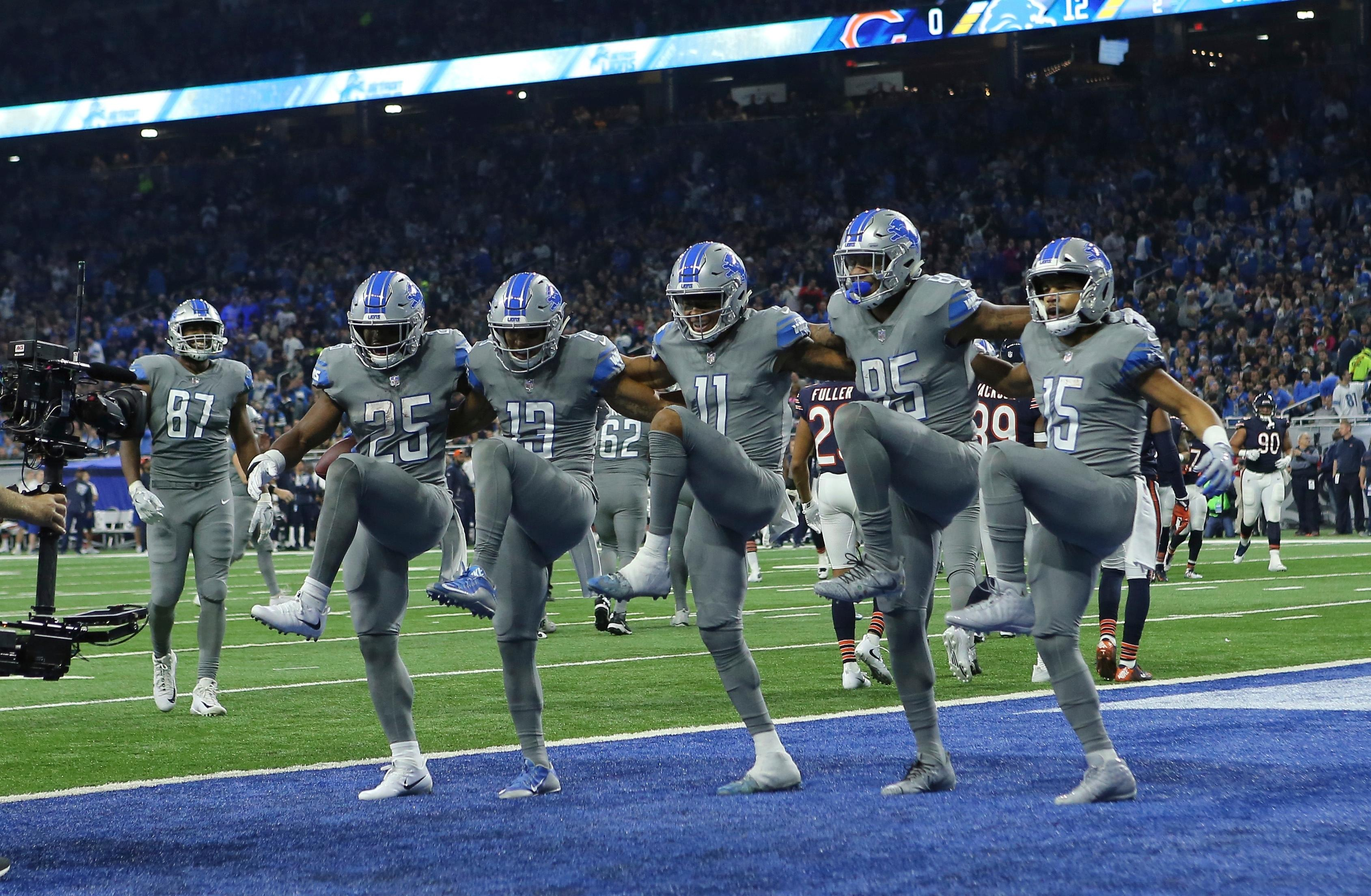The Detroit Lions form a dance line after a touchdown by wide receiver T.J. Jones (13) during the first half of an NFL football game against the Chicago Bears, Saturday, Dec. 16, 2017, in Detroit. (AP Photo/Rey Del Rio)
