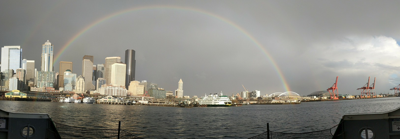 A full rainbow arcs over downtown Seattle, Tuesday, April 18, 2017. (Photo: Joe Lancheros)