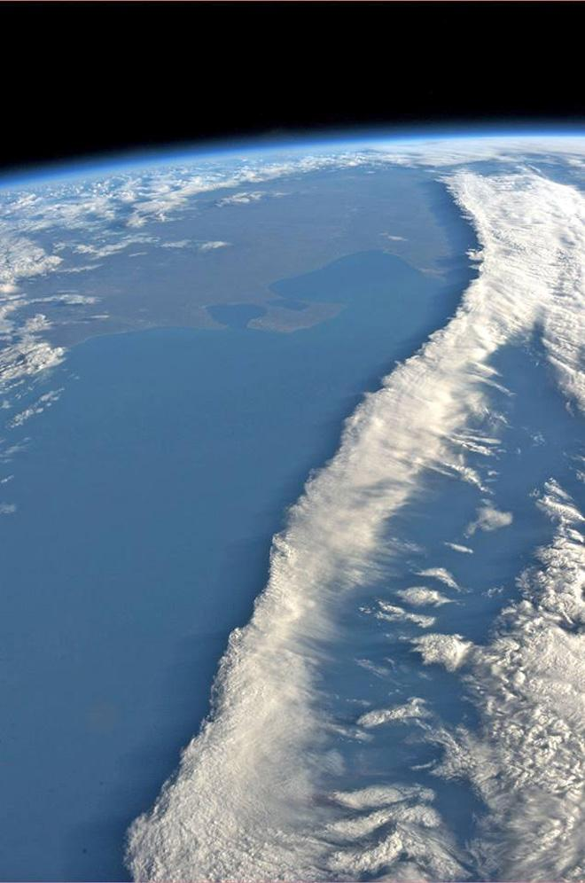 A ribbon of clouds intersecting the coast of Argentina. (Photo & Caption: Karen Nyberg, NASA)
