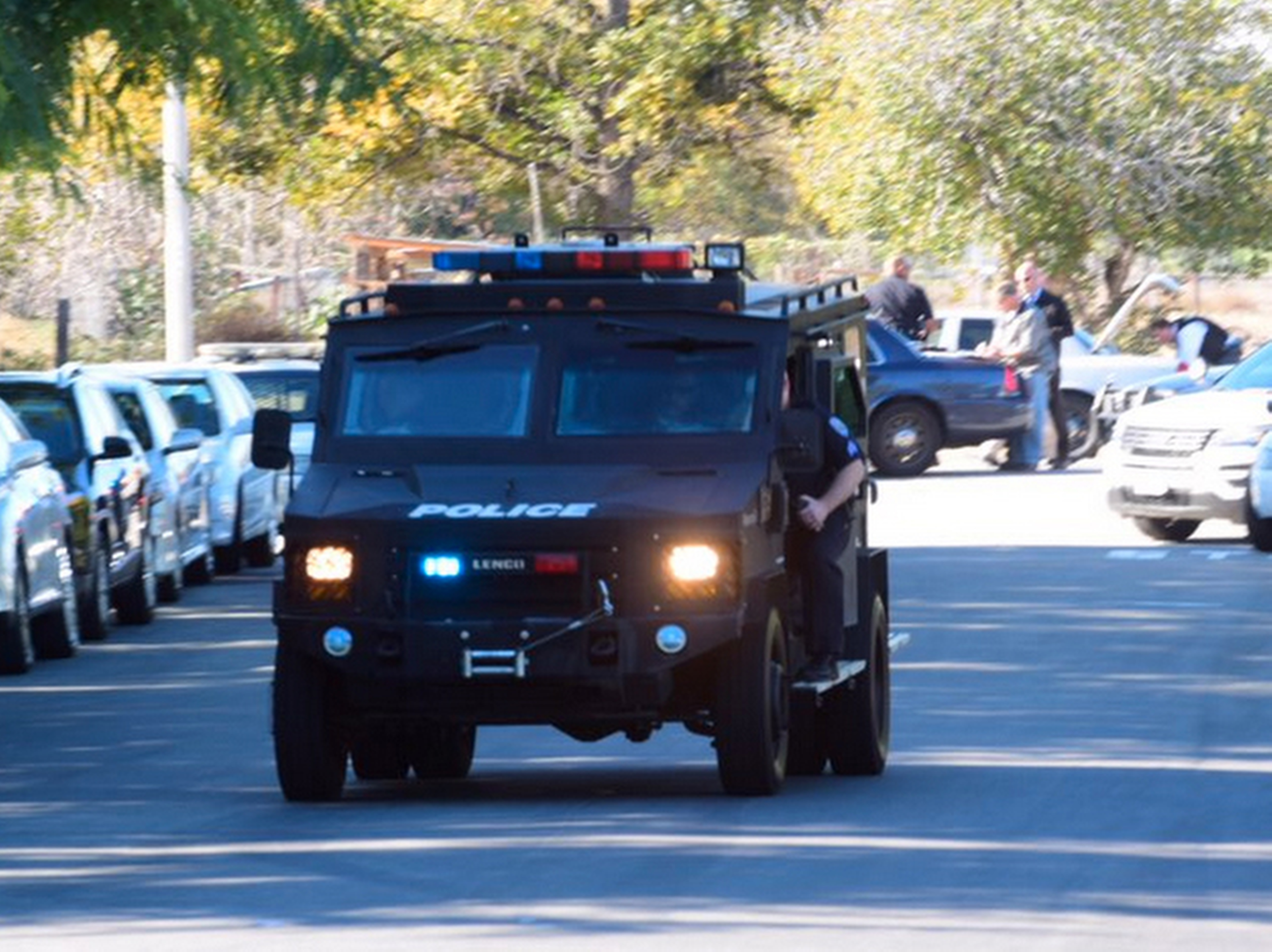 A swat team arrives at the scene of a shooting in San Bernardino, Calif., on Wednesday,  Dec. 2, 2015.  Police responded to reports of an active shooter at a social services facility. (Doug Saunders/Los Angeles News Group via AP)