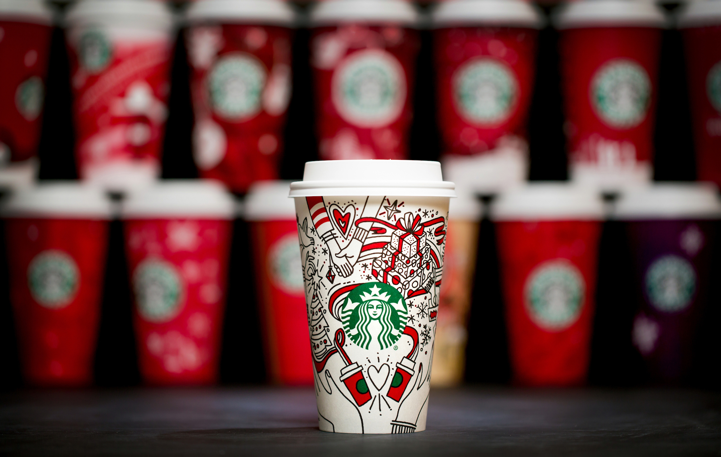 For 20 years, Starbucks have released a range of holiday cup designs, most of them based around their world famous red cup. It's not easy to find the very first Starbucks holiday cups, which made their debut in stores in 1997. Few were saved, and electronic design files were lost in an earthquake in 2001. Even an Internet search is unyielding, with the cups having made their arrival long before the first selfie. But, we have them here! Click on for a photos of all 20 holidays cup designs. (Image: Joshua Trujillo/Cover Images)